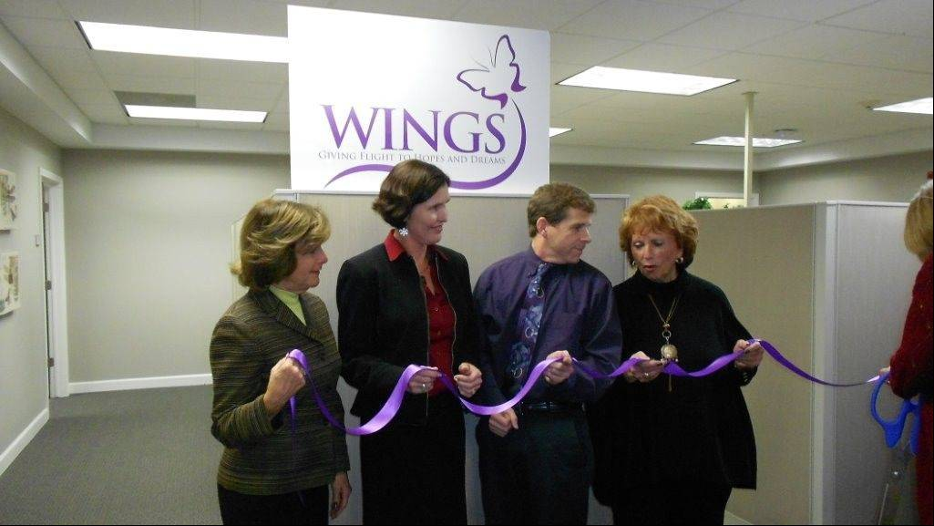 COURTESY OF WINGSA recent ribbon cutting for moving WINGS to Rolling Meadows. Participants include Rita Canning, Board Chair; from left, Rebecca Darr, CEO WINGS; Mayor Tom Rooney; and Laurie Stone, Board President.
