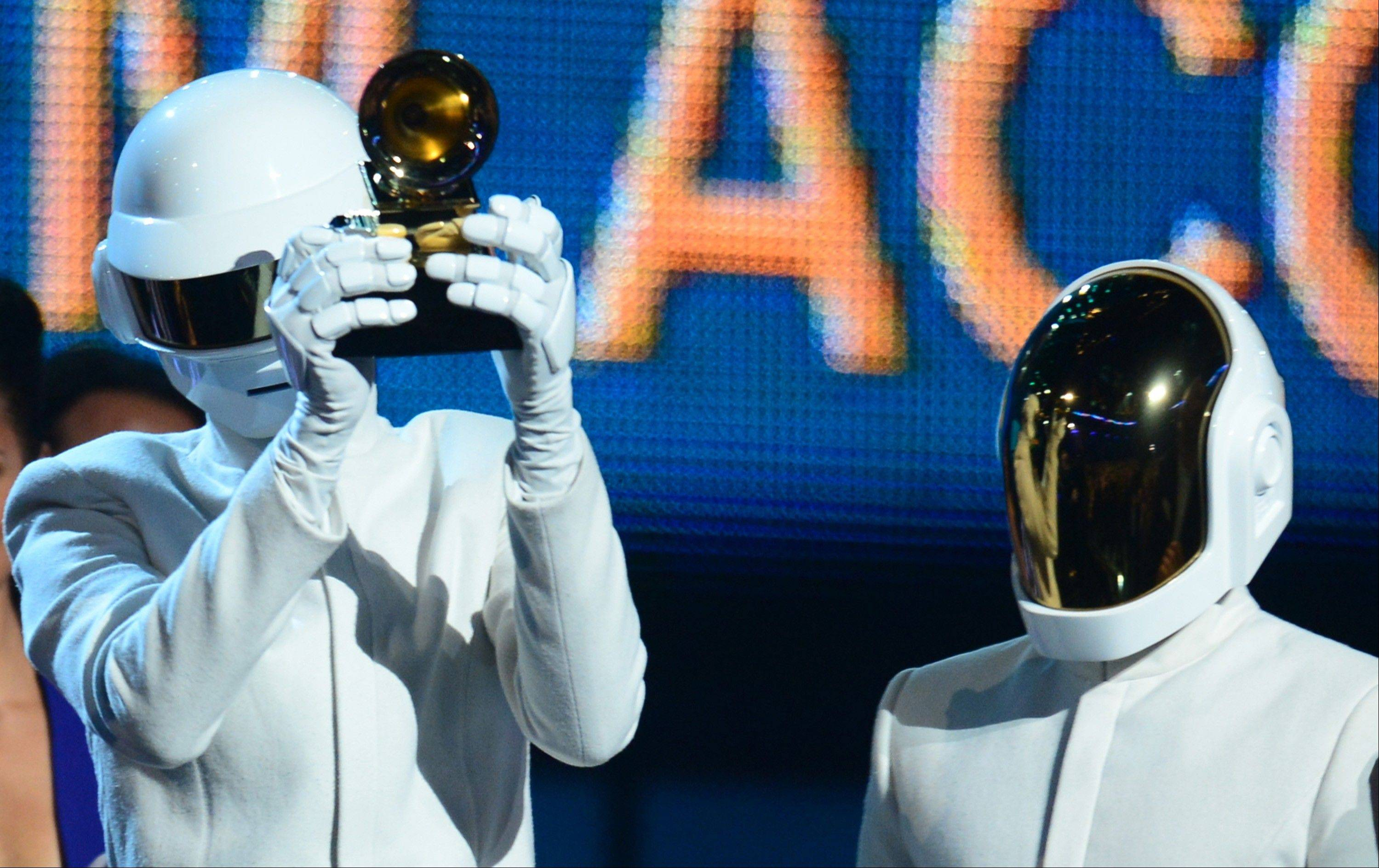 "Winners for Best Record of the Year with ""Get Lucky,"" Daft Punk celebrate their award onstage at the 56th Grammy Awards Sunday."