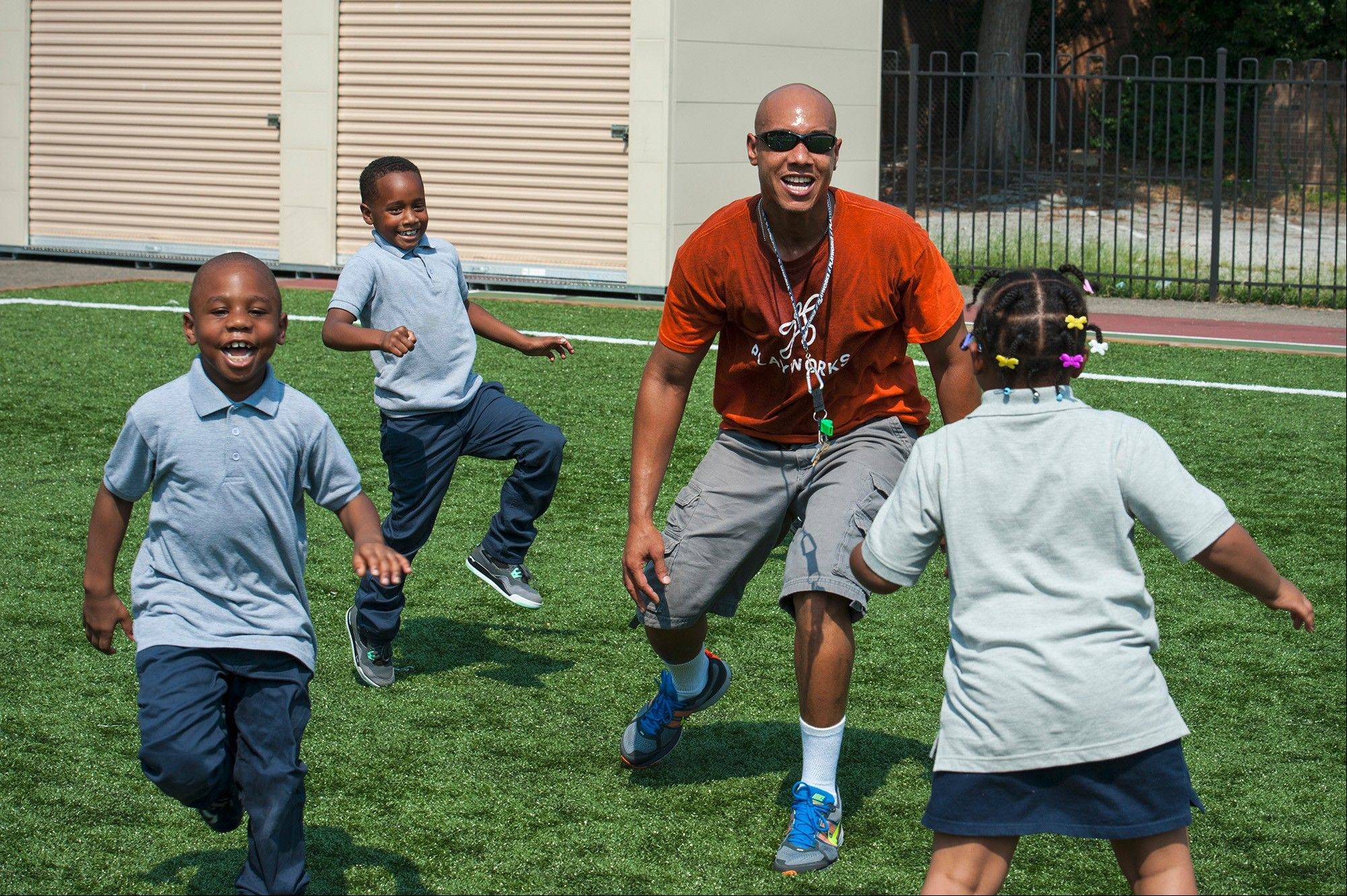 Katherine Frey/The Washington Post Playworks D.C. coach Leevon Floyd plays with first-graders Keon Hopkins, Tyrin Segar and Makayla Naper at Amidon-Bowen Elementary School in Washington. A nonprofit organization that started in Oakland, Calif., Playworks believes recess can teach kids conflict resolution and other life skills.