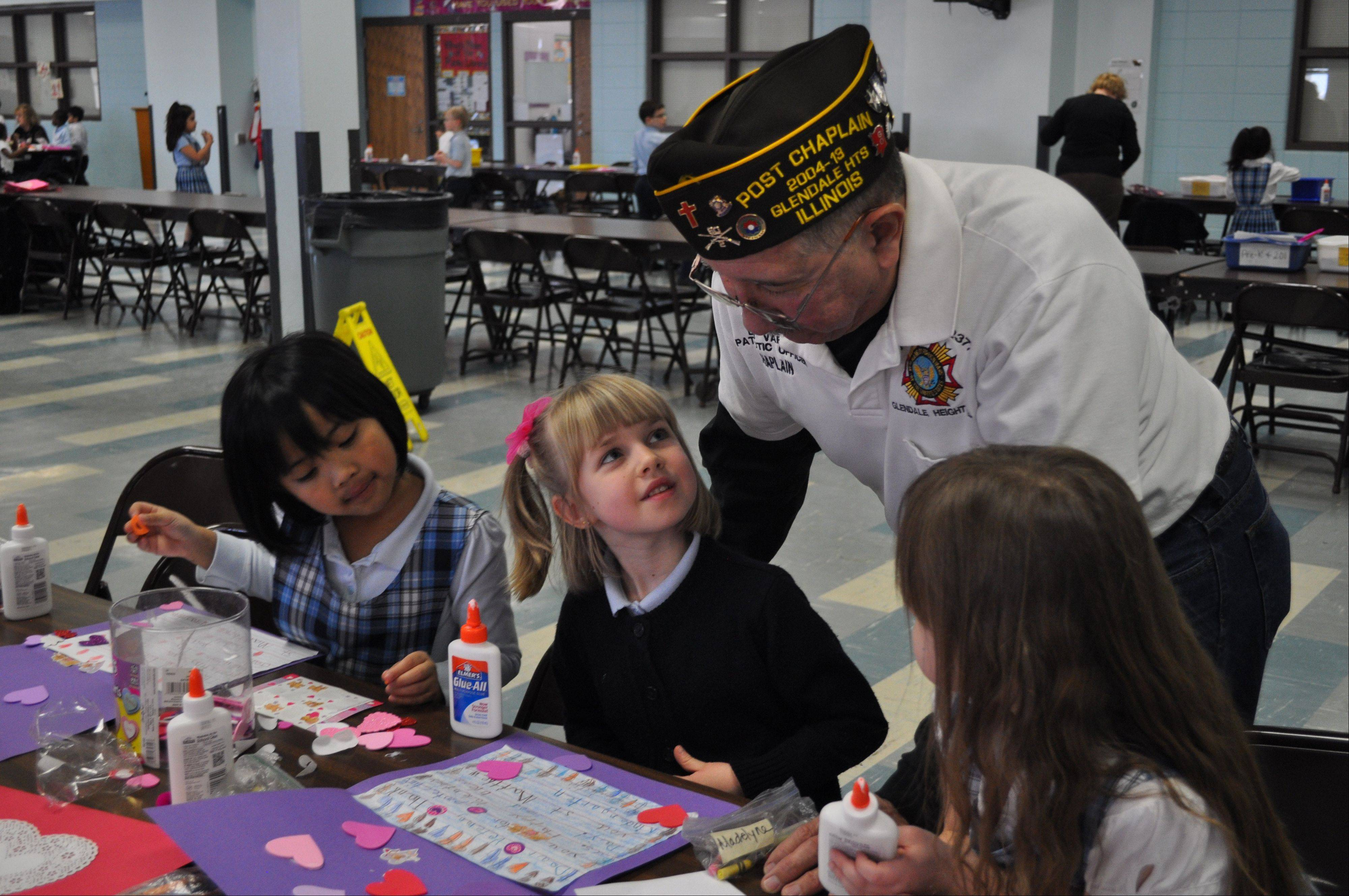 Bob Vargas, Member of VFS Post 2377, helps decorate valentines with St. Matthew School students for the Glendale Heights Valentines for Veterans program.
