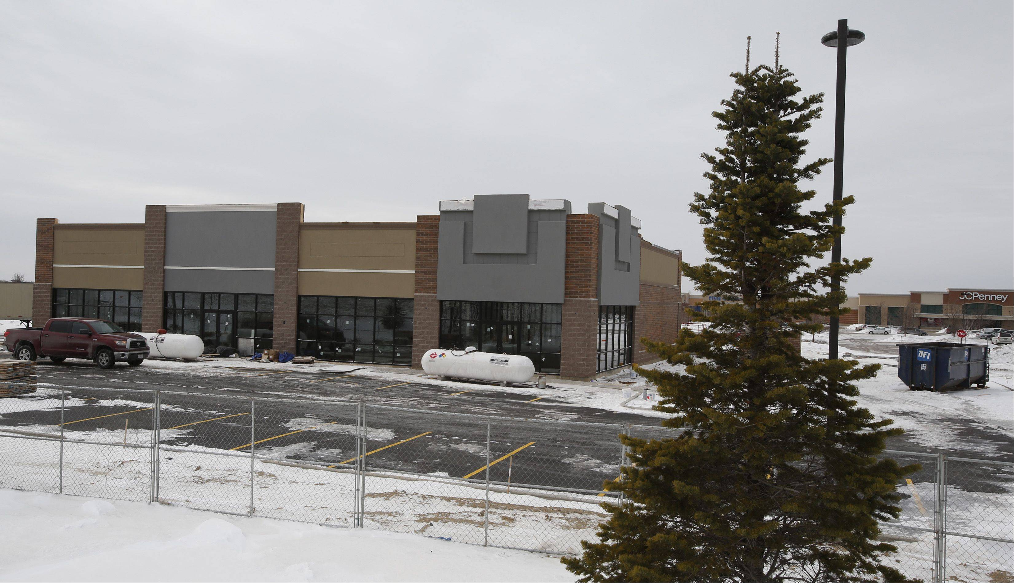 A pair of businesses will occupy this new building under construction east of the JCPenney store on Randall Road in Algonquin.