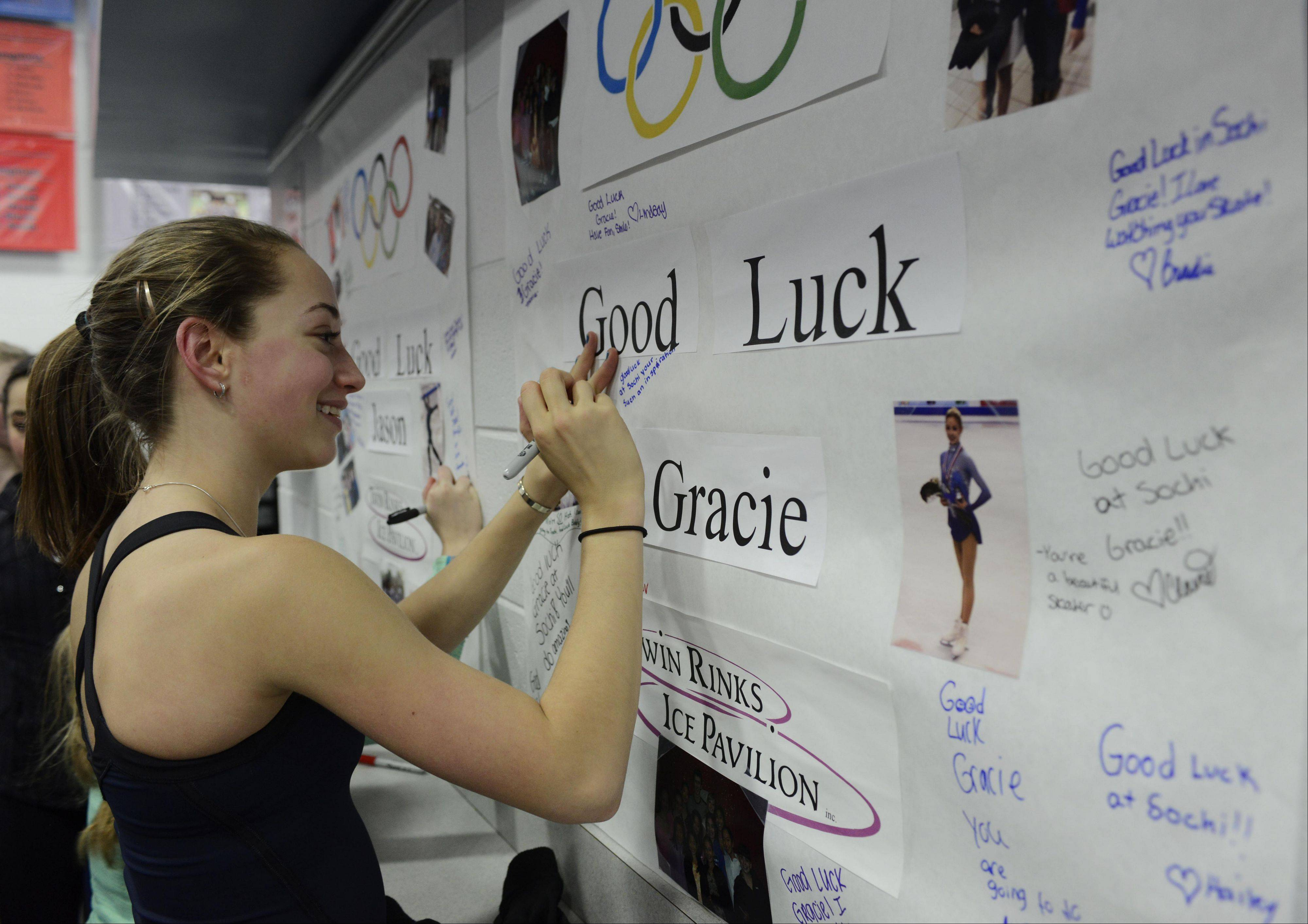 Rudi Baruch of Buffalo Grove signs cards for Olympians Gracie Gold and Jason Brown at Twin Rinks Ice Pavilion in Buffalo Grove.