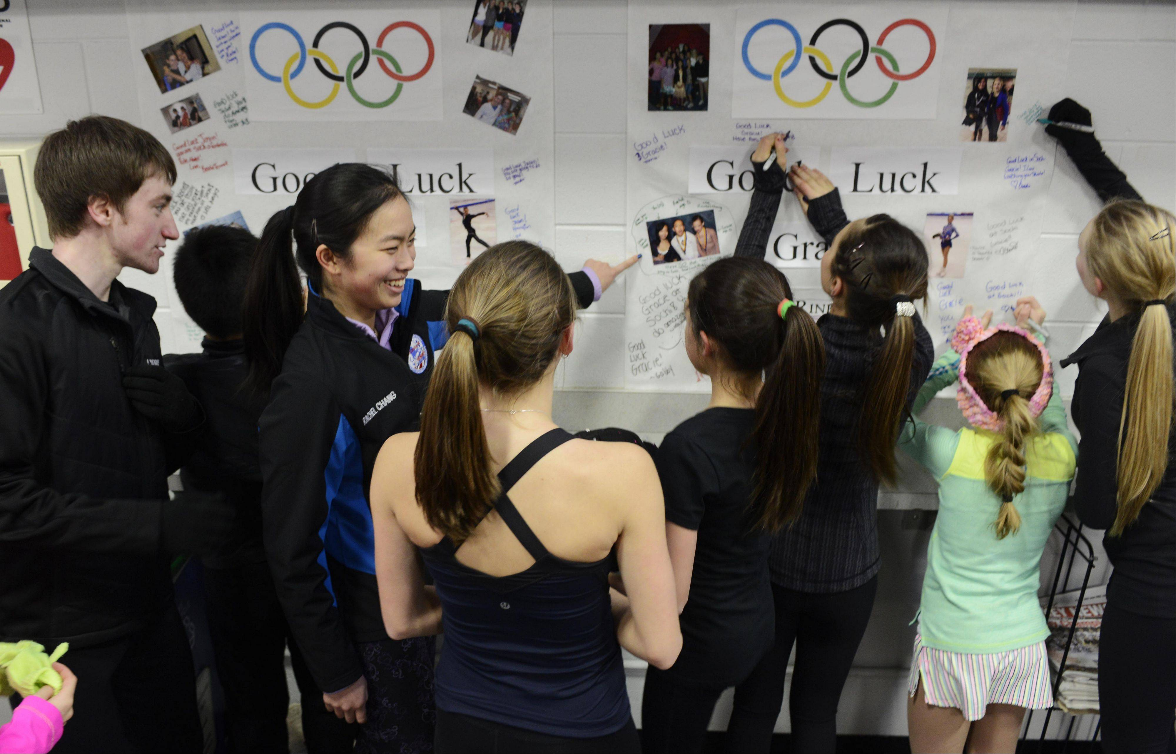 Skaters sign cards for Gracie Gold and Jason Brown, which the Olympians will get before they pack up for Sochi.