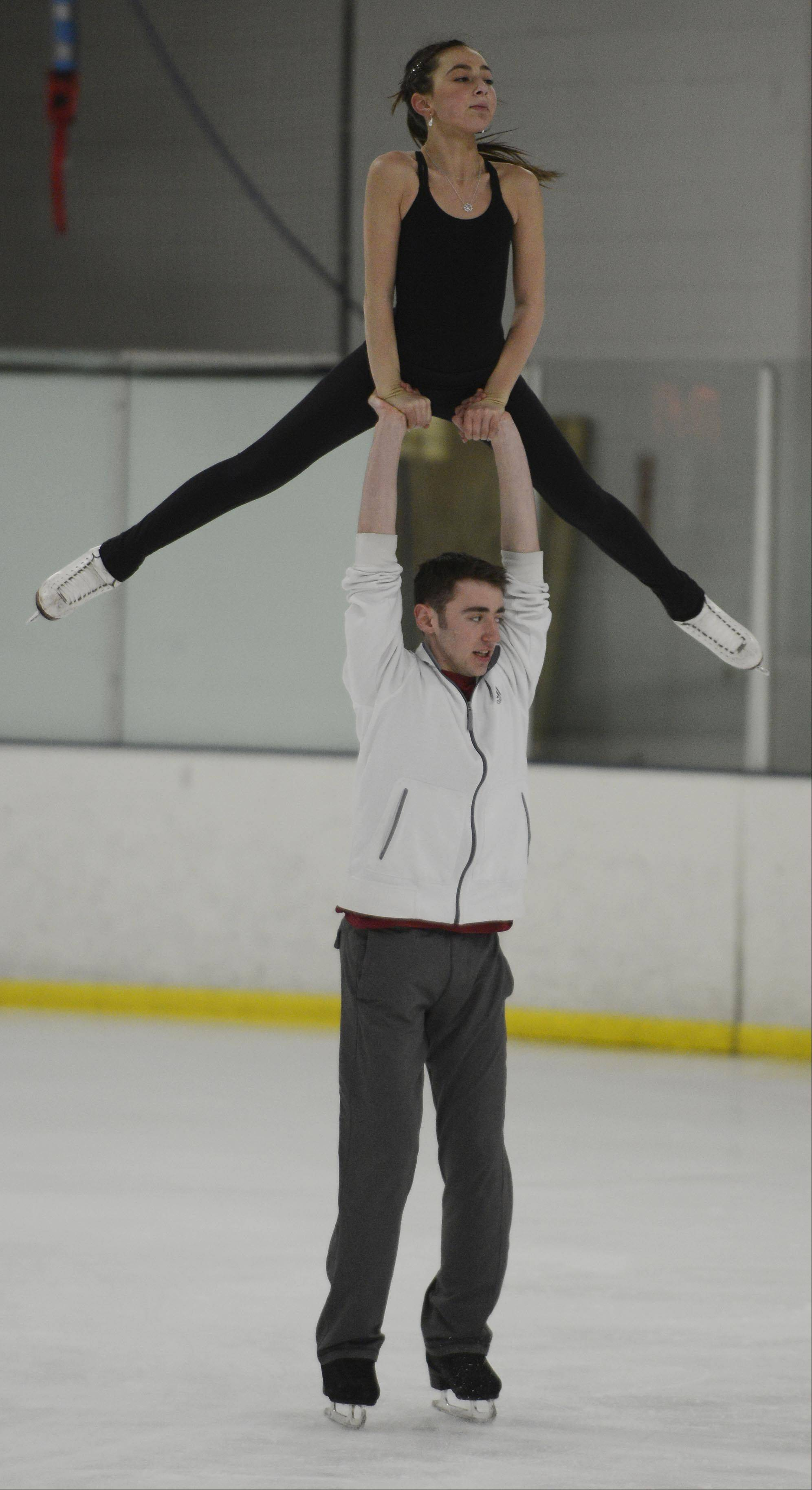 Novice pairs skaters Lindsay Weinstein of Buffalo Grove and Jacob Simon of Highland Park skate practice at Twin Rinks.