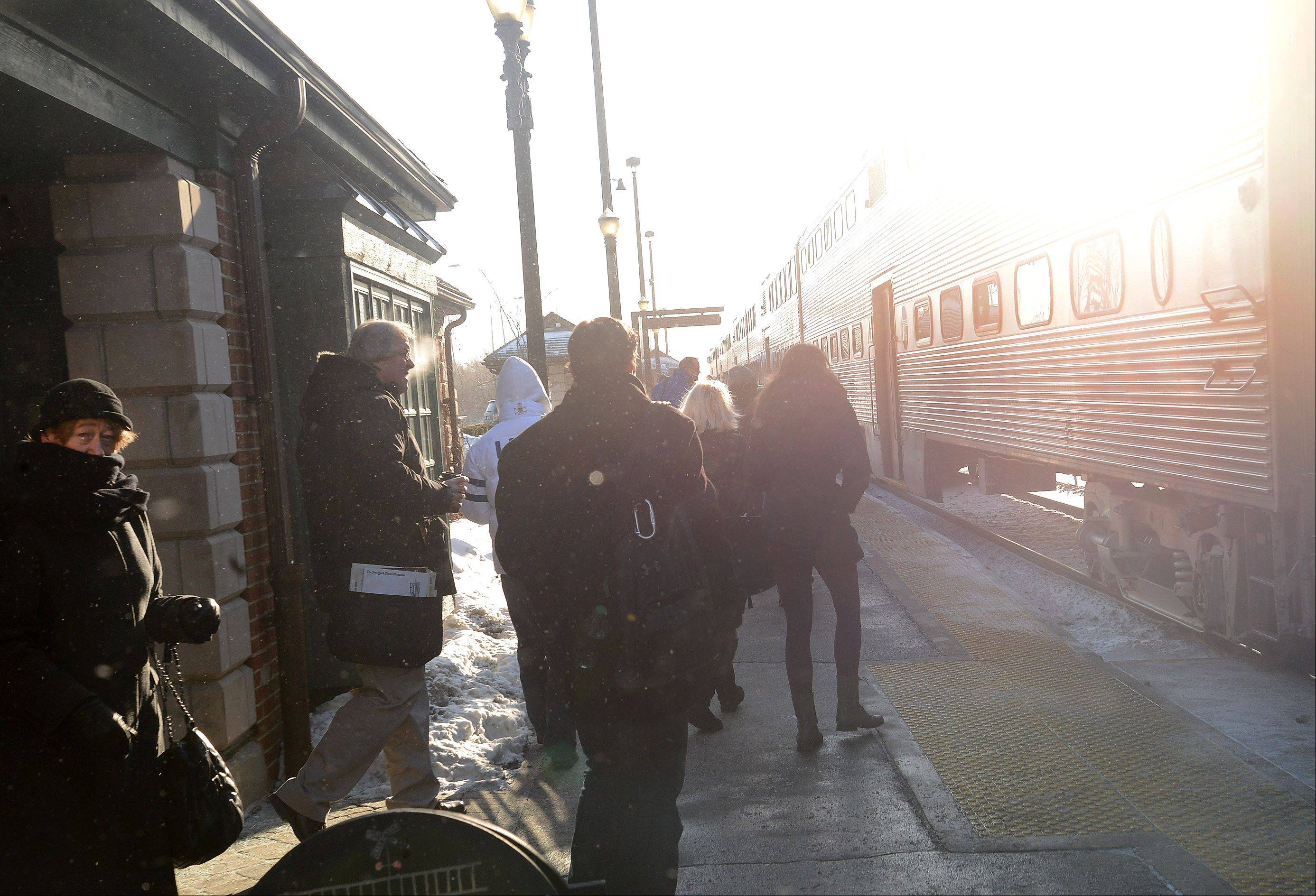 Frozen commuters board the Metra train at the Barrington train station.