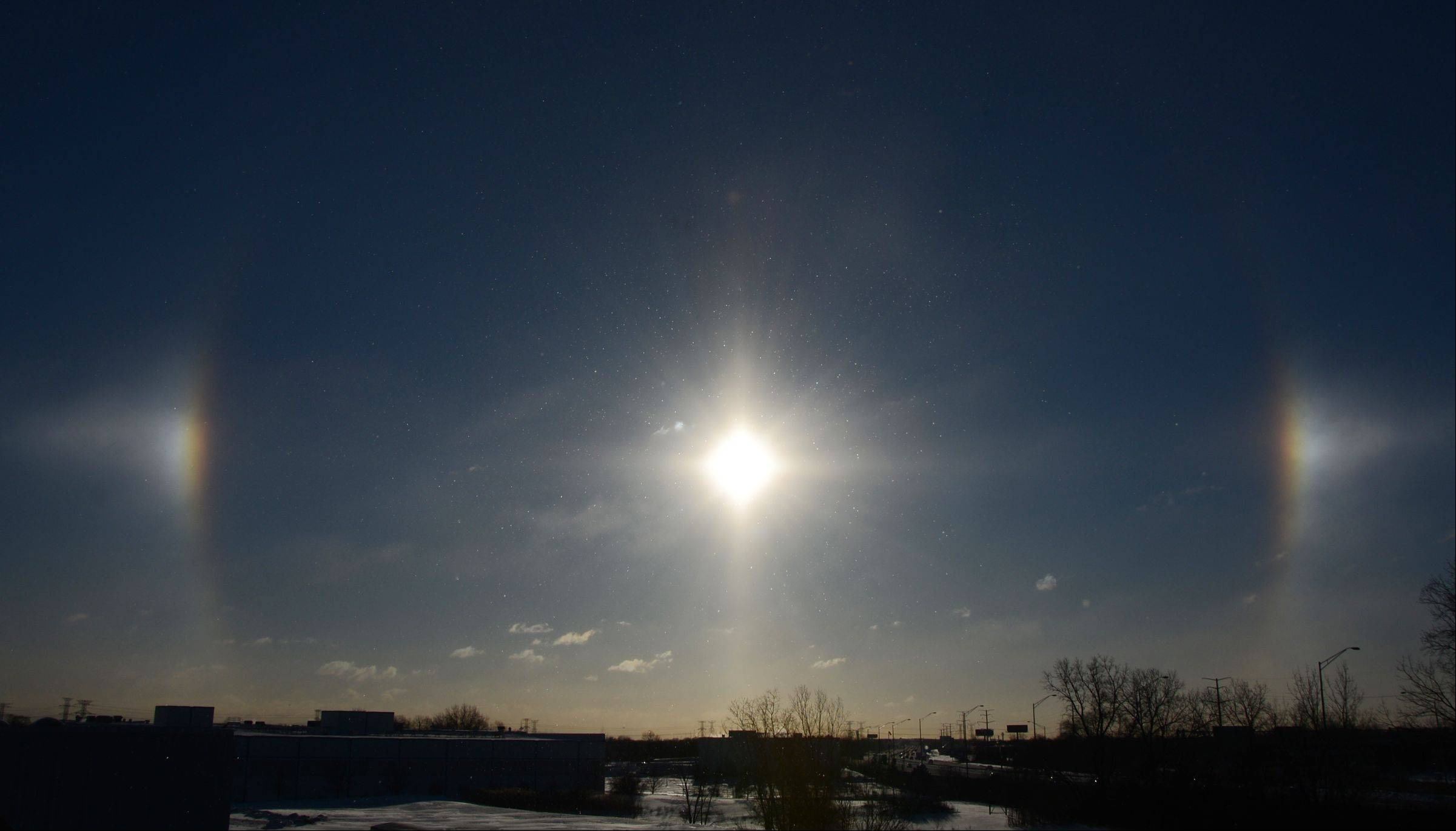 A sun dog over the Jane Addams Tollway in Arlington Heights Monday morning. Sun dogs are caused by sunlight passing through ice crystals in the upper atmosphere.