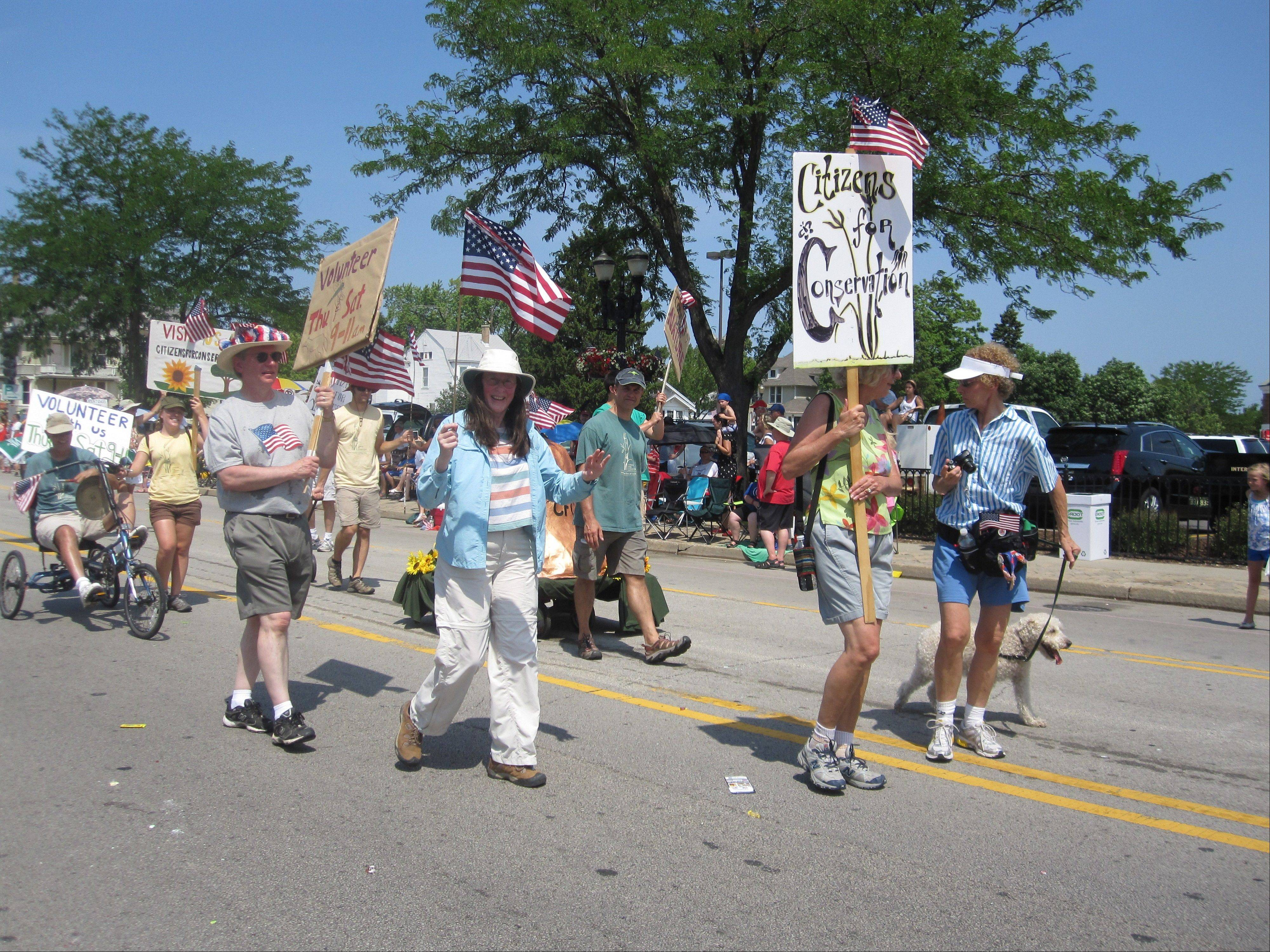 Citizens for Conservation members walk in the 2012 Barrington 4th of July parade, winners of the Village President's Award.