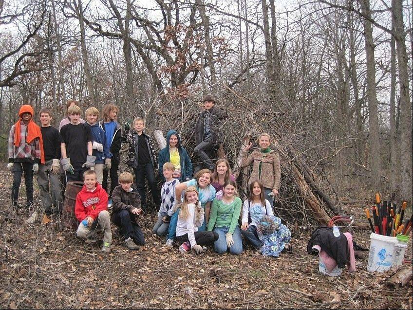 Students and teachers from Wauconda's Da Vinci Waldorf School perform an afternoon of service for Citizens for Conservation at Flint Creek Savanna South.