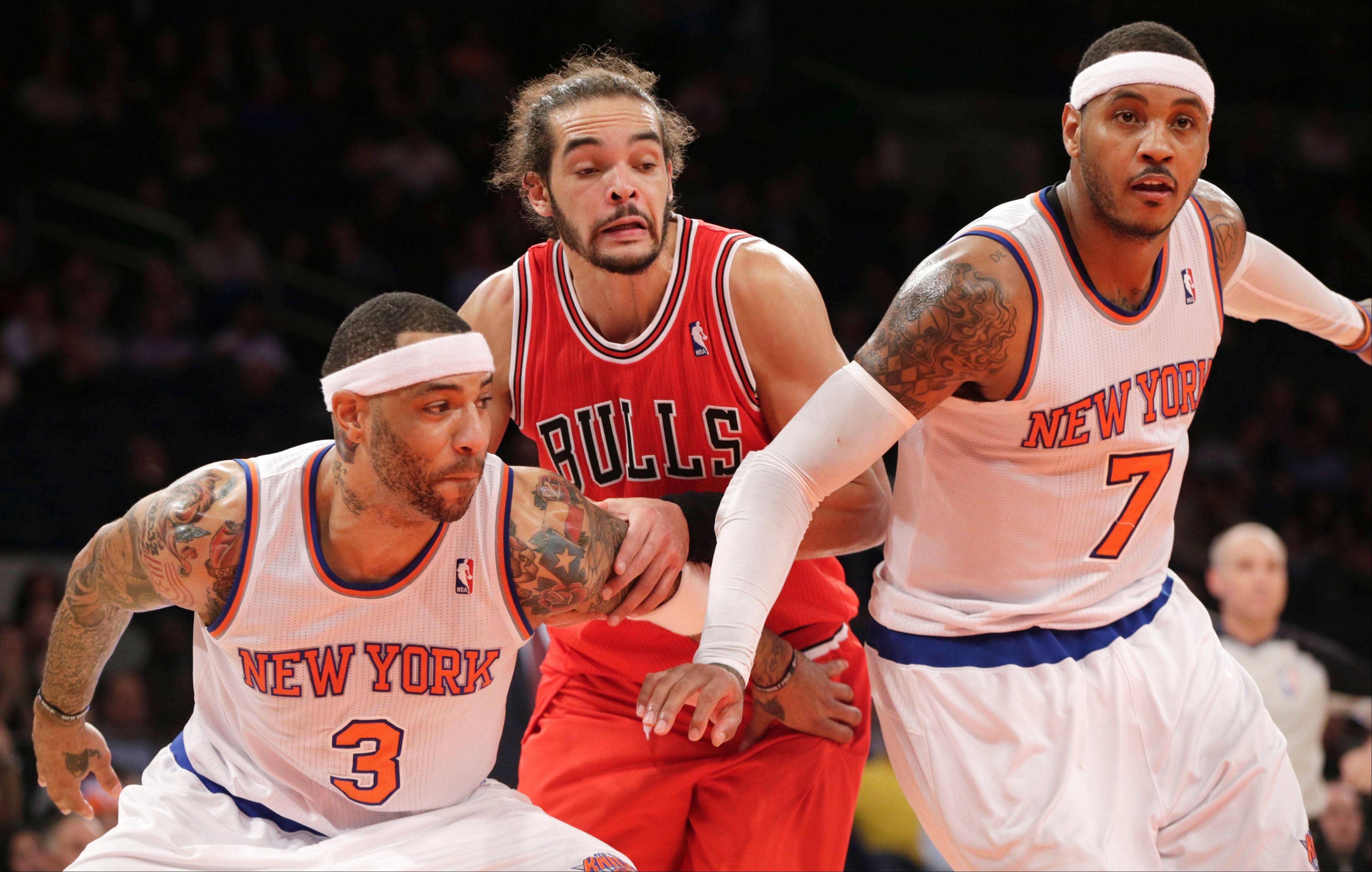 New York Knicks forward Kenyon Martin (3) and New York Knicks forward Carmelo Anthony (7) defend Bulls center Joakim Noah on a rebound in a game earlier this season.