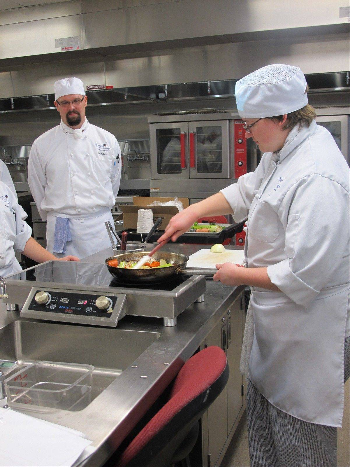 MCC student Kelly Braun of McHenry carmalizes vegetables for a stock during a Culinary Skills II class.