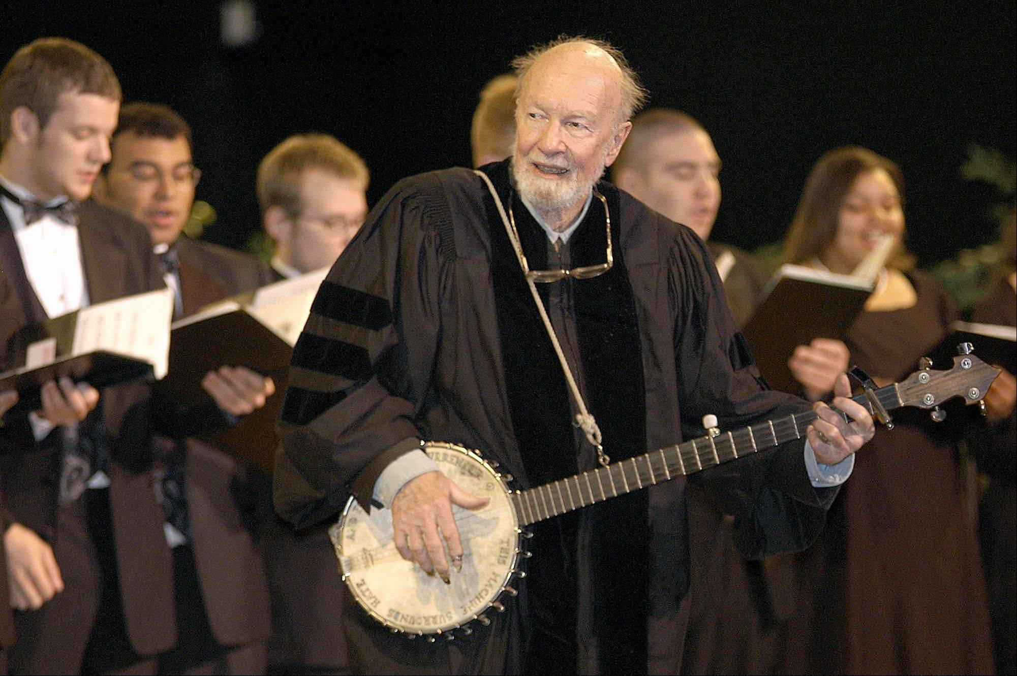Folk singer Pete Seeger performed �When the Saints Go Marching In� with the Saint Rose Chamber Singers during commencement ceremonies for the College of St. Rose at the Empire State Plaza in Albany, N.Y. in 2003. The American troubadour, folk singer and activist died Monday at age 94.