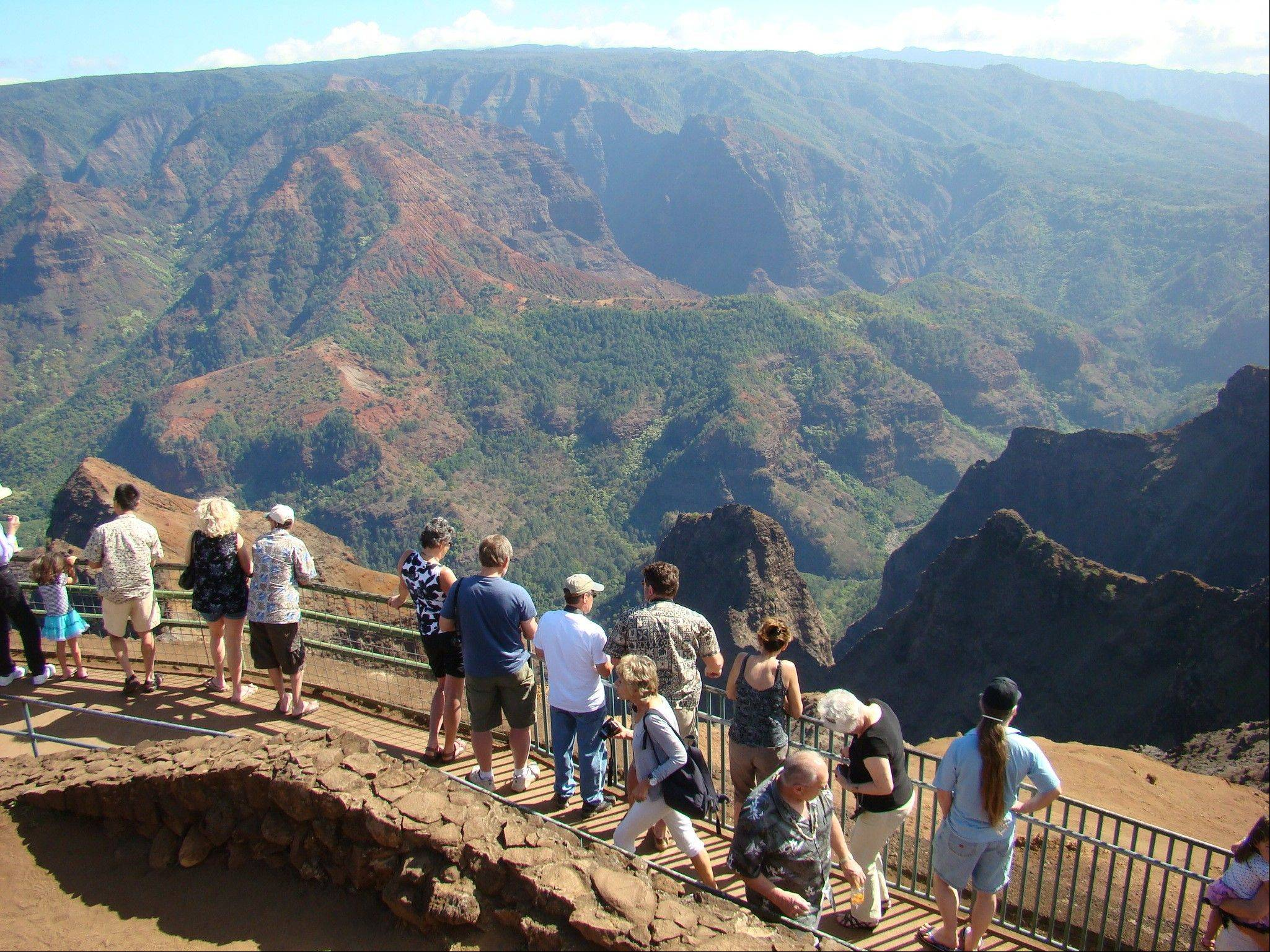 Tourists line up to view Waimea Canyon on the island of Kauai, Hawaii. The natural wonder has been dubbed the Grand Canyon of the Pacific.
