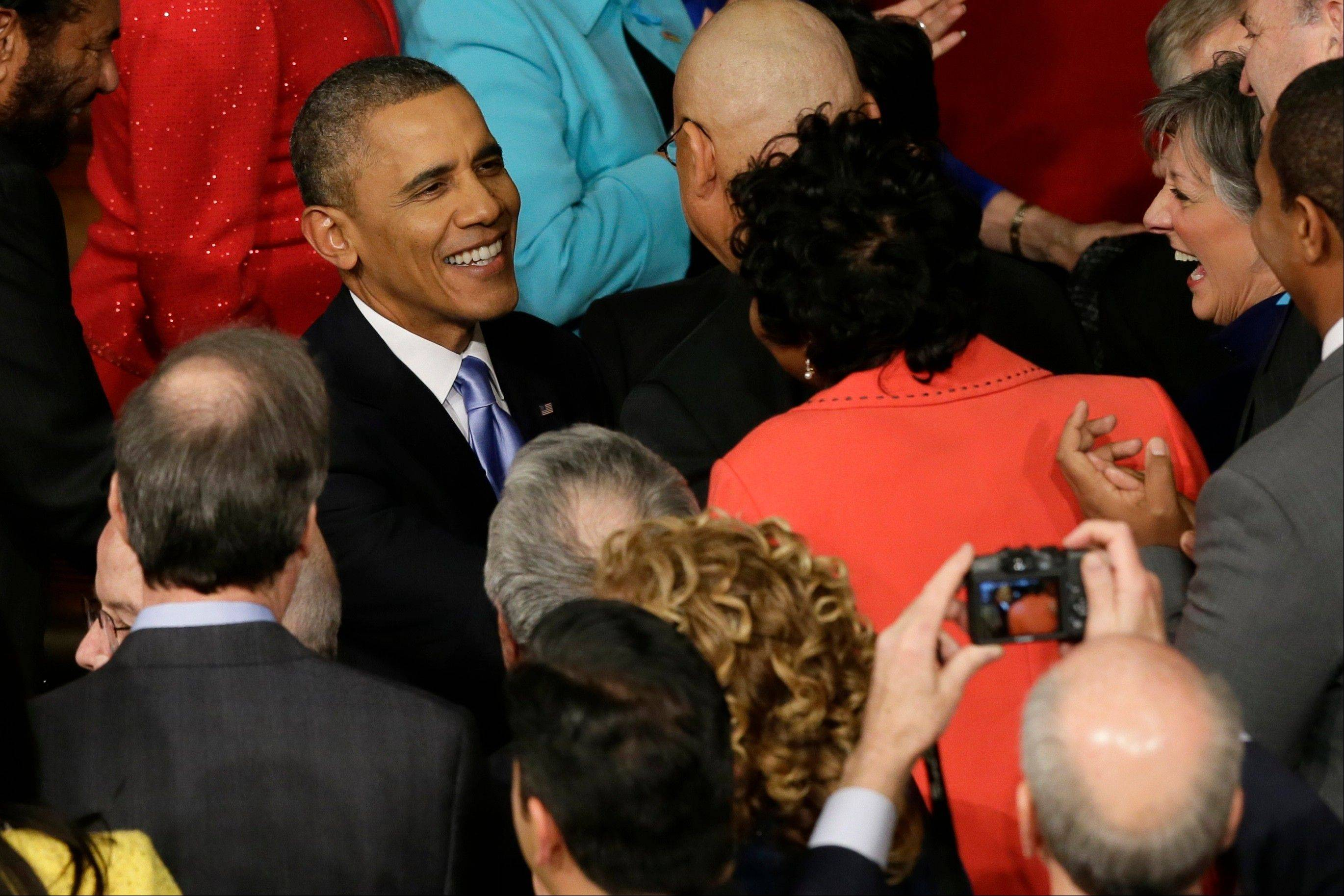 President Barack Obama is greeted as he arrives to give his State of the Union address on Capitol Hill Tuesday.