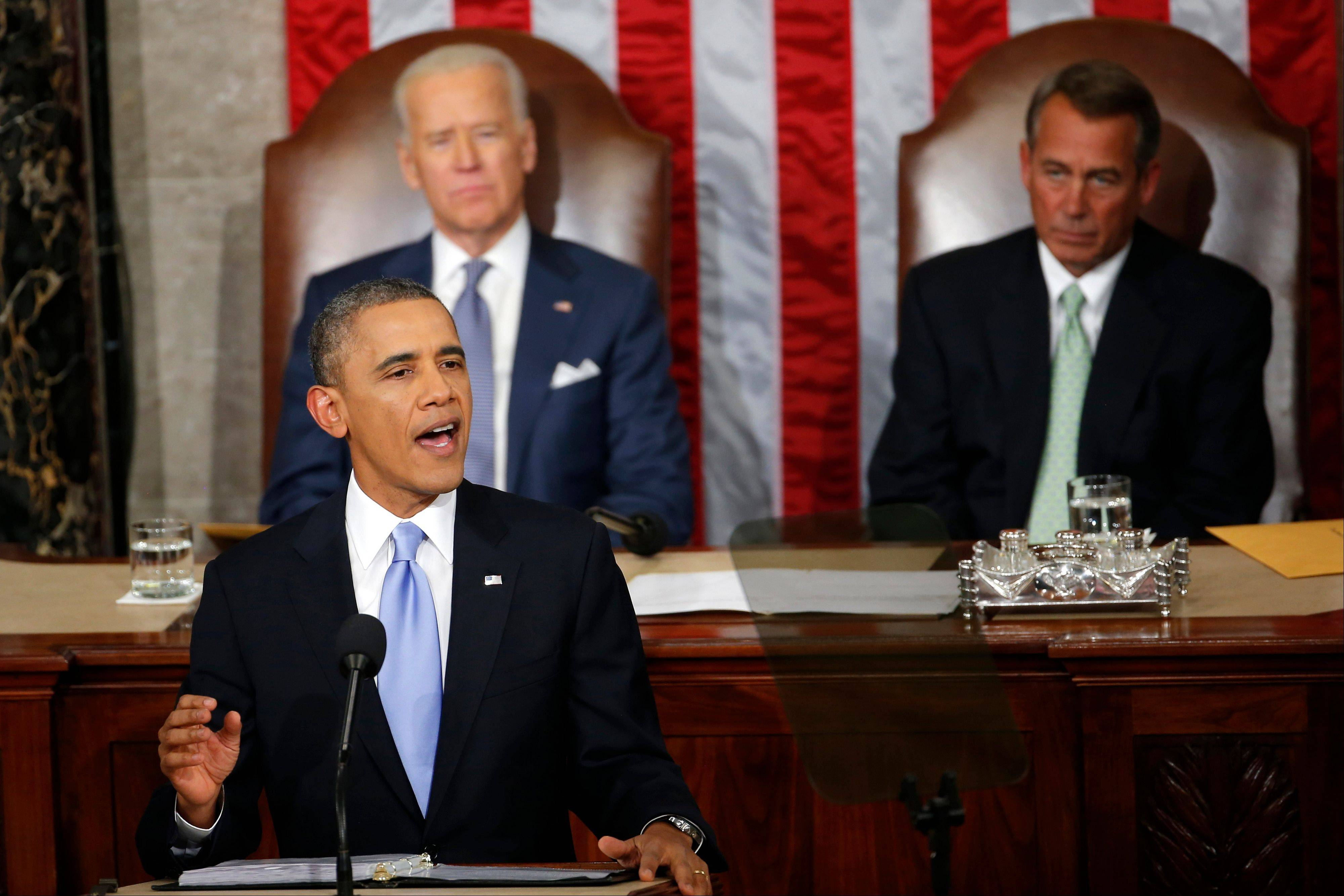 President Barack Obama gives his State of the Union address on Capitol Hill Tuesday, as Vice President Joe Biden and House Speaker John Boehner of Ohio listen.