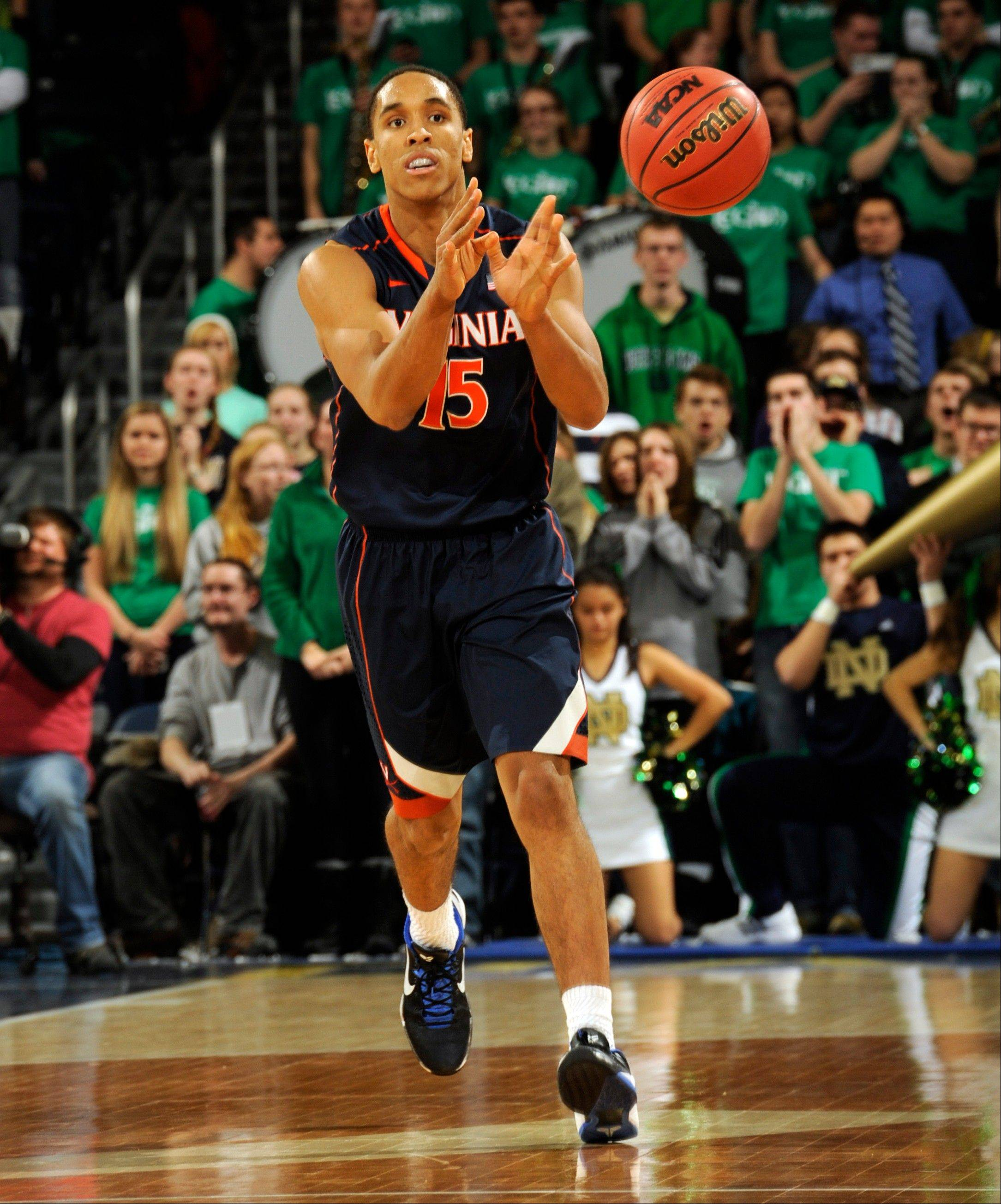 Virginia guard Malcolm Brogdon passes the ball during Tuesday night�s game against Notre Dame in South Bend, Ind. Virginia beat the Irish 68-53.