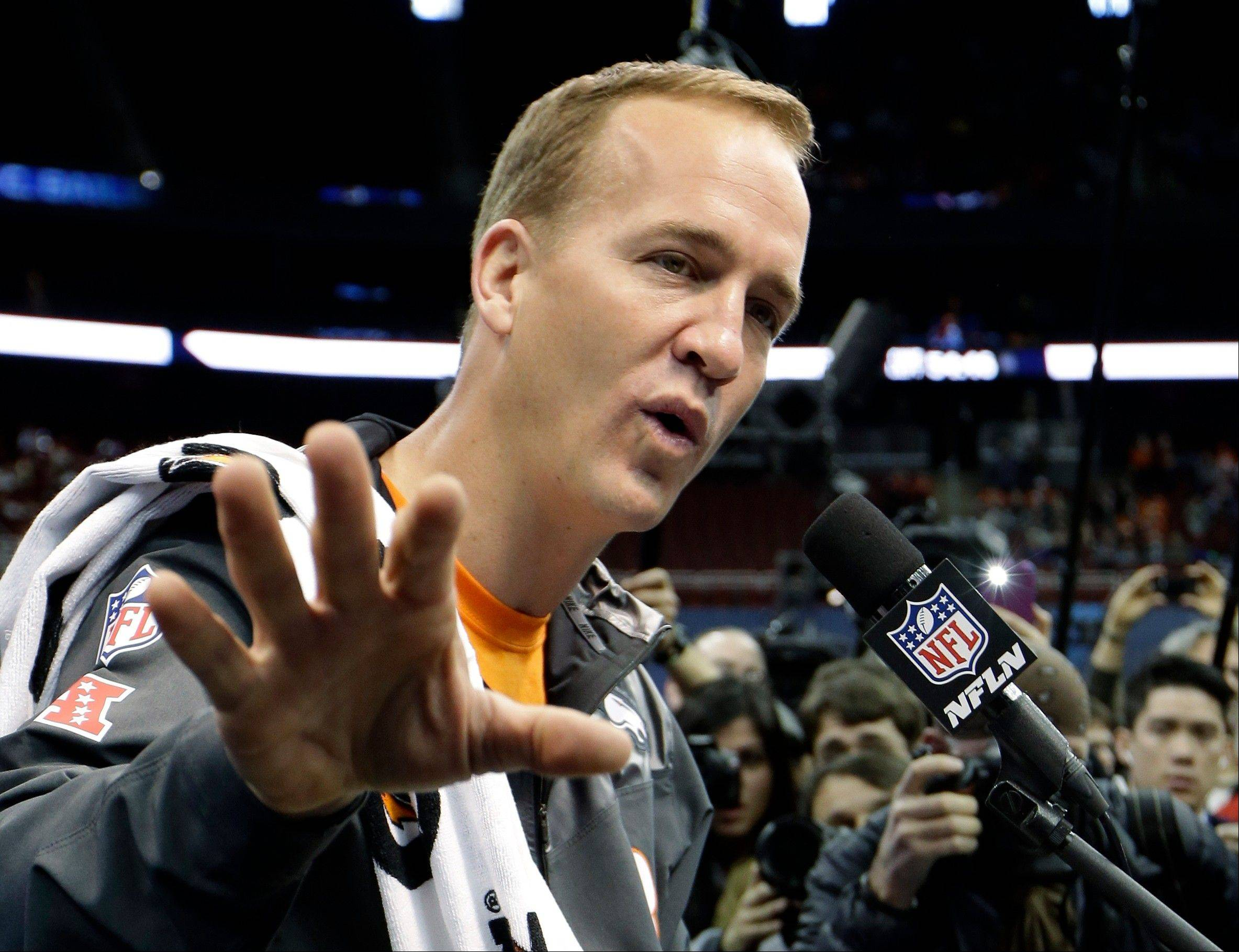 Denver Broncos� Peyton Manning answers a question during media day for the NFL Super Bowl XLVIII football game Tuesday, Jan. 28, 2014, in Newark, N.J.