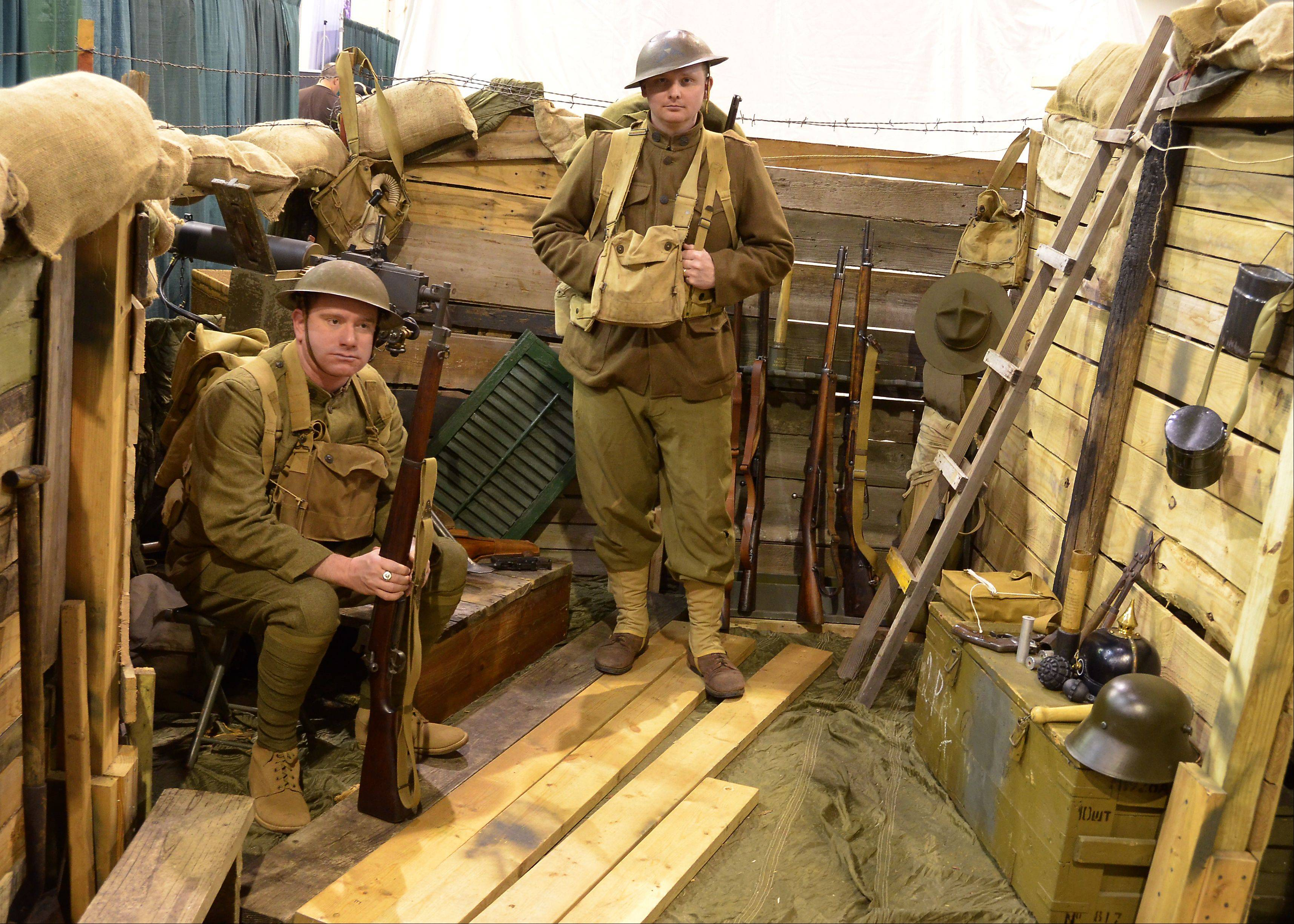 Bill Zars/bzars@dailyherald.com ¬ George Bruckert, left, of Lisle and Bill Thurston of Oswego spent some time in a World War l trench at a previous edition of the Military History Fest convention at Pheasant Run Resort in St. Charles.