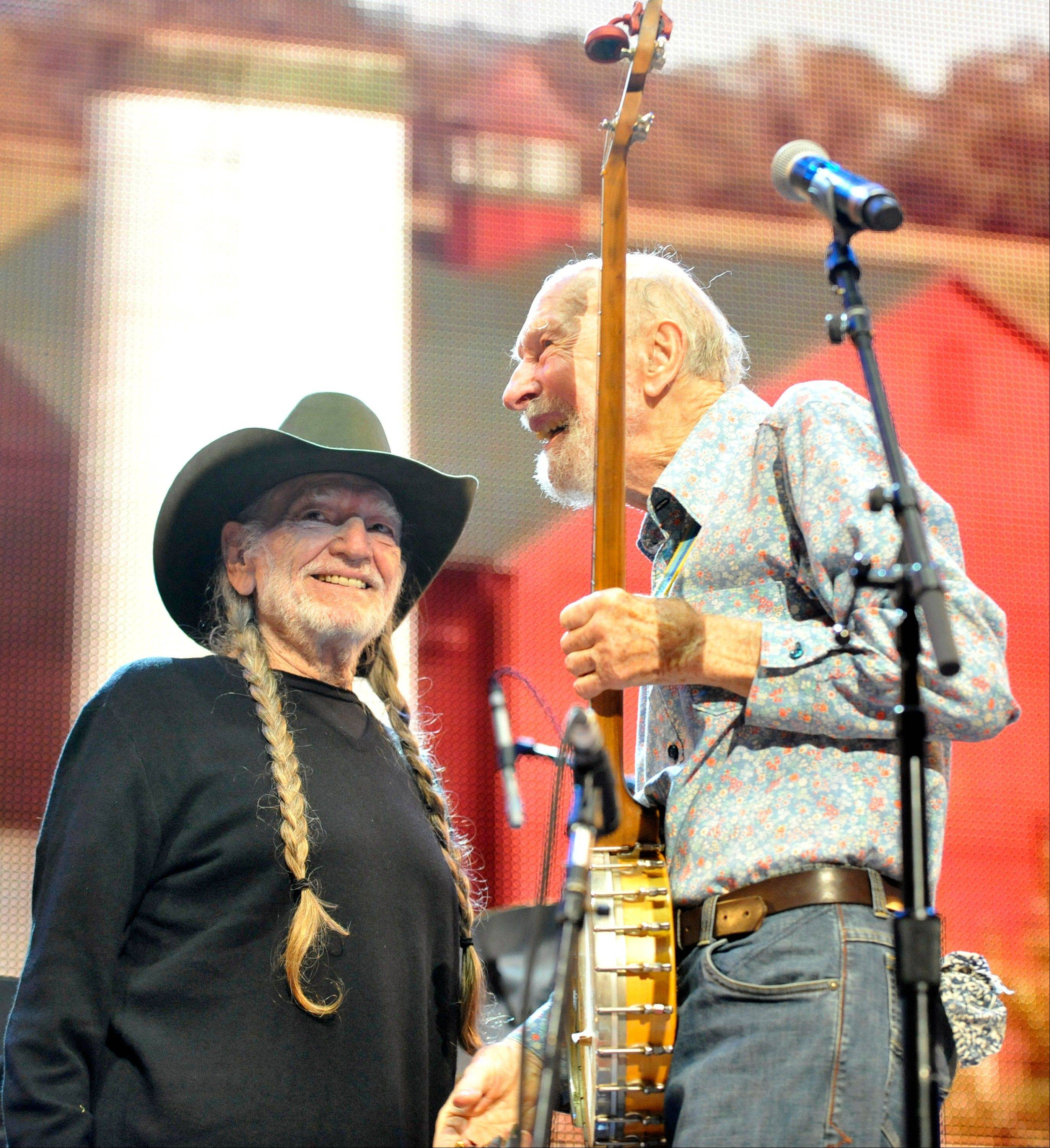 Pete Seeger, right, and Willie Nelson performed during the Farm Aid 2013 concert at Saratoga Performing Arts Center in Saratoga Springs, N.Y. Seeger died Monday at age 94.