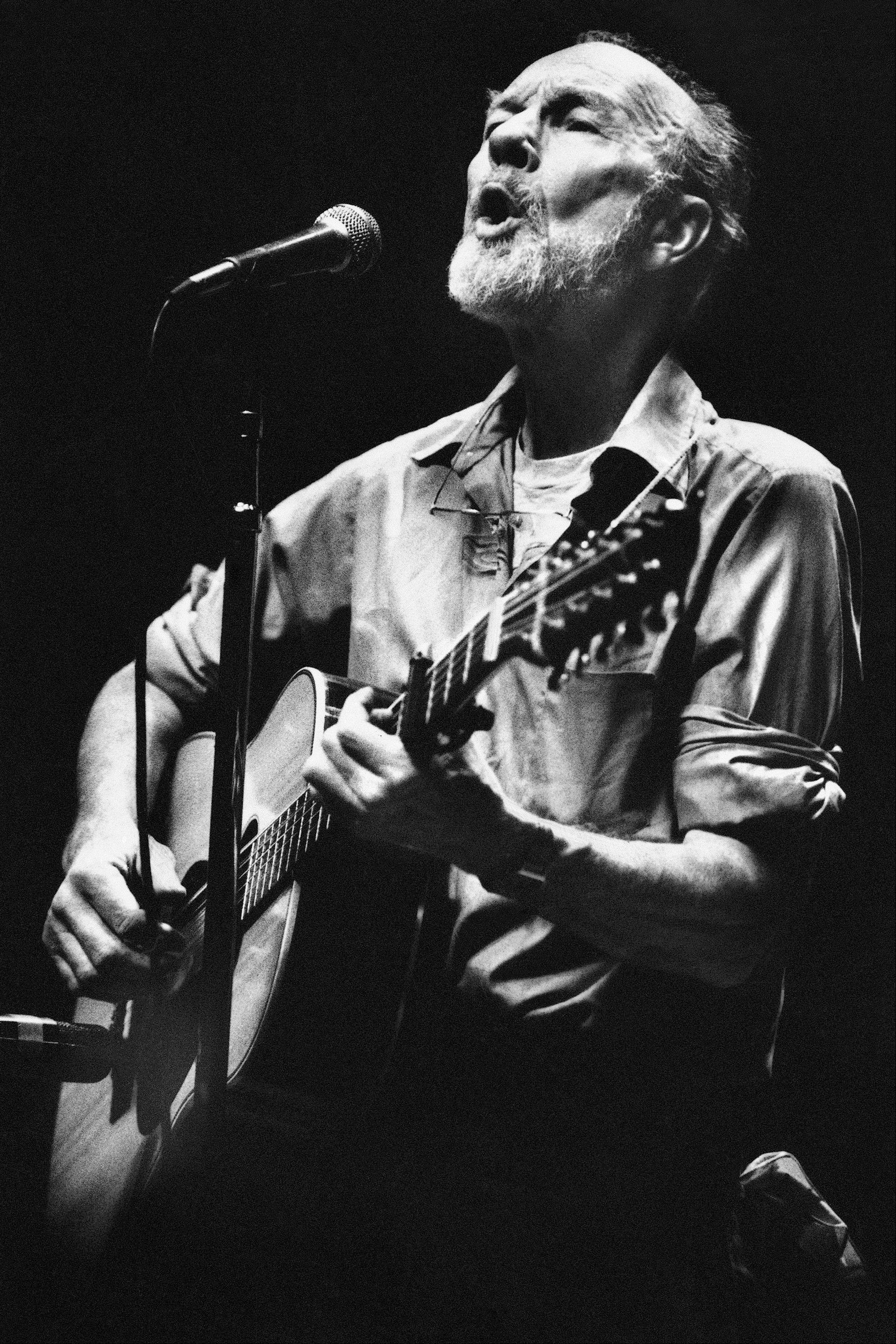 Folk singer Pete Seeger performed in a one-man benefit concert in Berkeley, Calif., at the Berkeley Community Theater in 1984. The American troubadour, folk singer and activist died Monday.