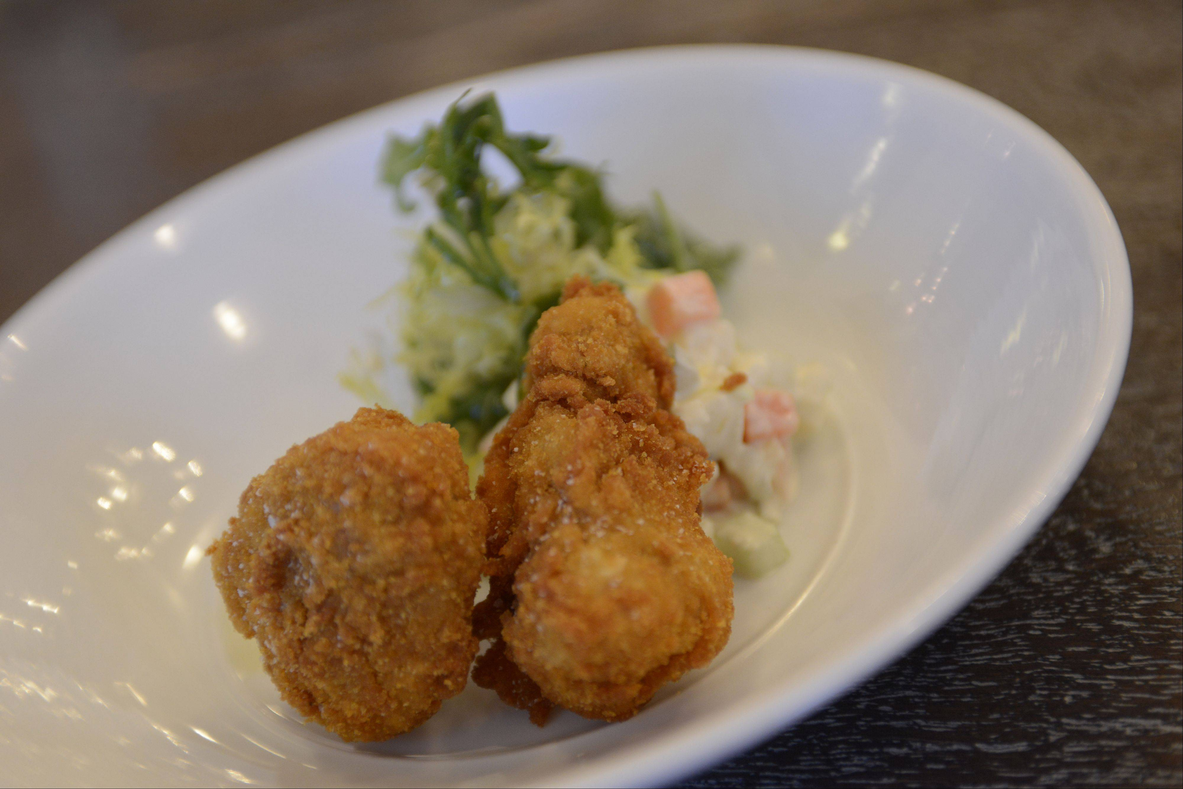 Sweetbreads get a crispy breading and are served with a frisee salad at Guildhall in Glencoe.