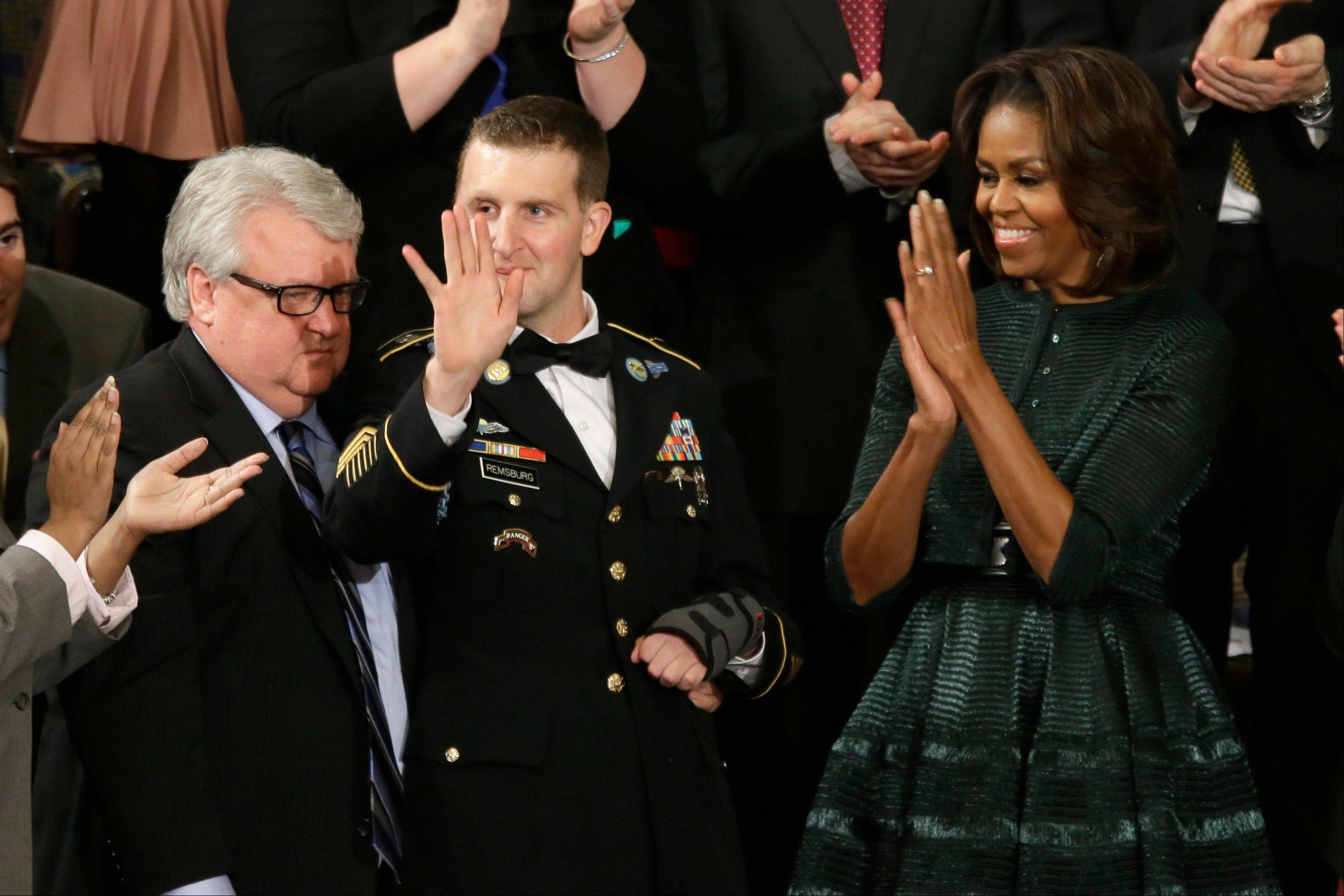 First lady Michelle Obama, and others, applaud Army Ranger Sgt. 1st Class Cory Remsburg, as President Barack Obama acknowledges him during his State of the Union address on Capitol Hill Tuesday.