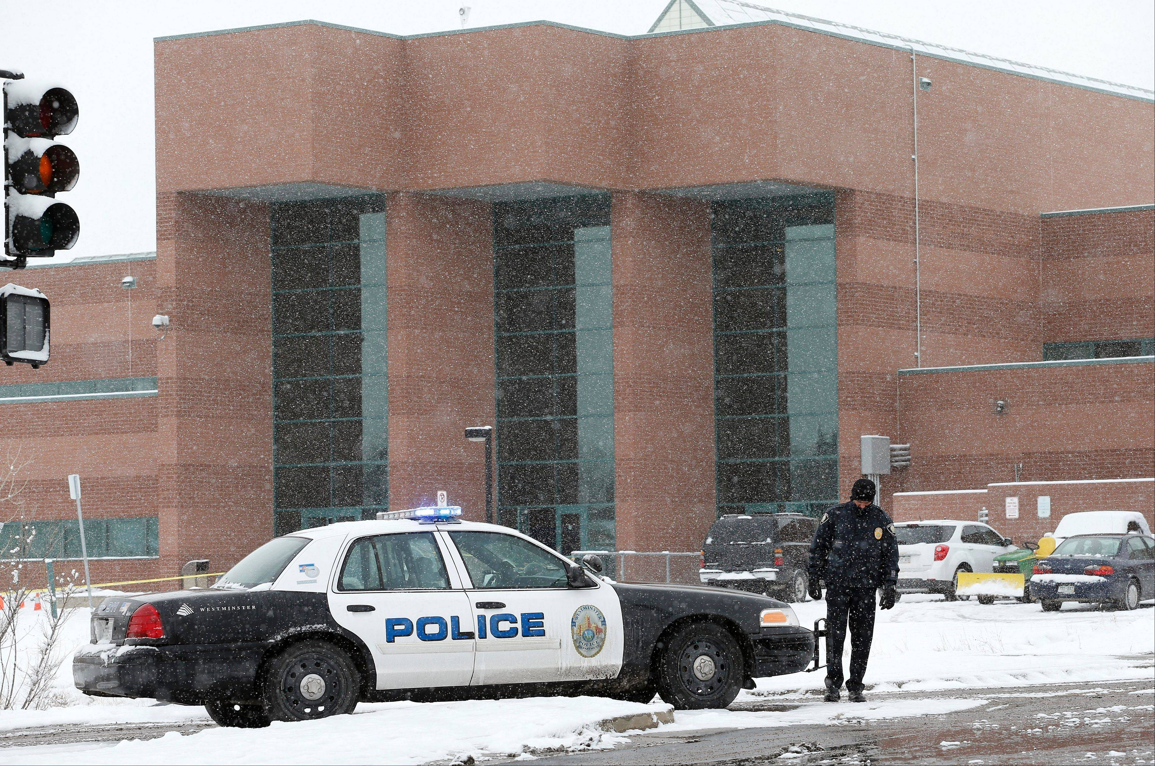 A police cruiser blocks the entrance to Standley Lake High School, where classes were canceled after an apparent suicide attempt by a student, in Westminster, Colo., Monday, Jan. 27, 2014. Police say a 16-year-old boy was critically injured after setting himself on fire at the suburban Denver high school.