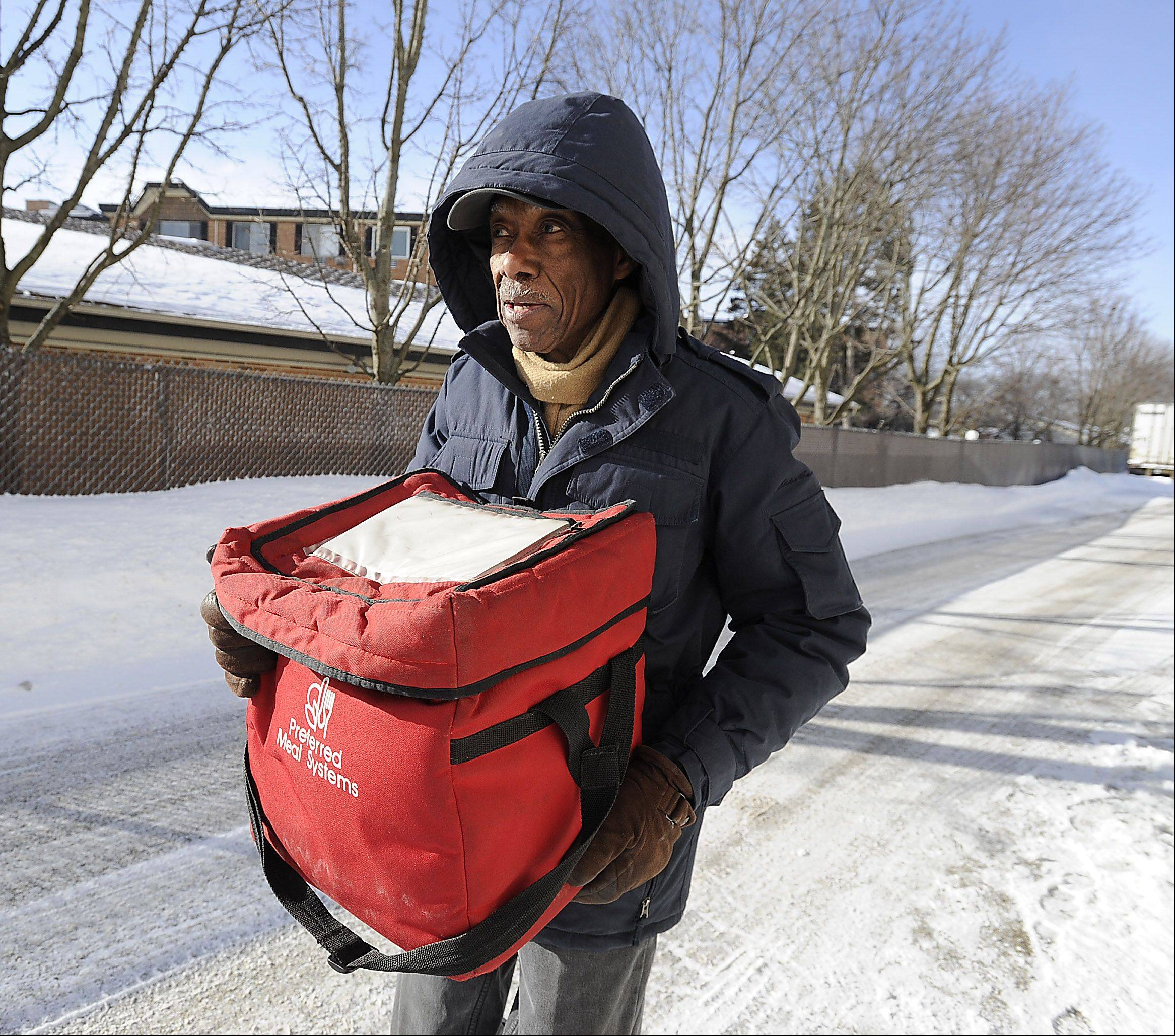 Meals on Wheels volunteer Samuel Grimes, 88, loads up his van Monday as he prepares to set out on his daily delivery run. The Des Plaines man brings meals to 34 clients five days a week.