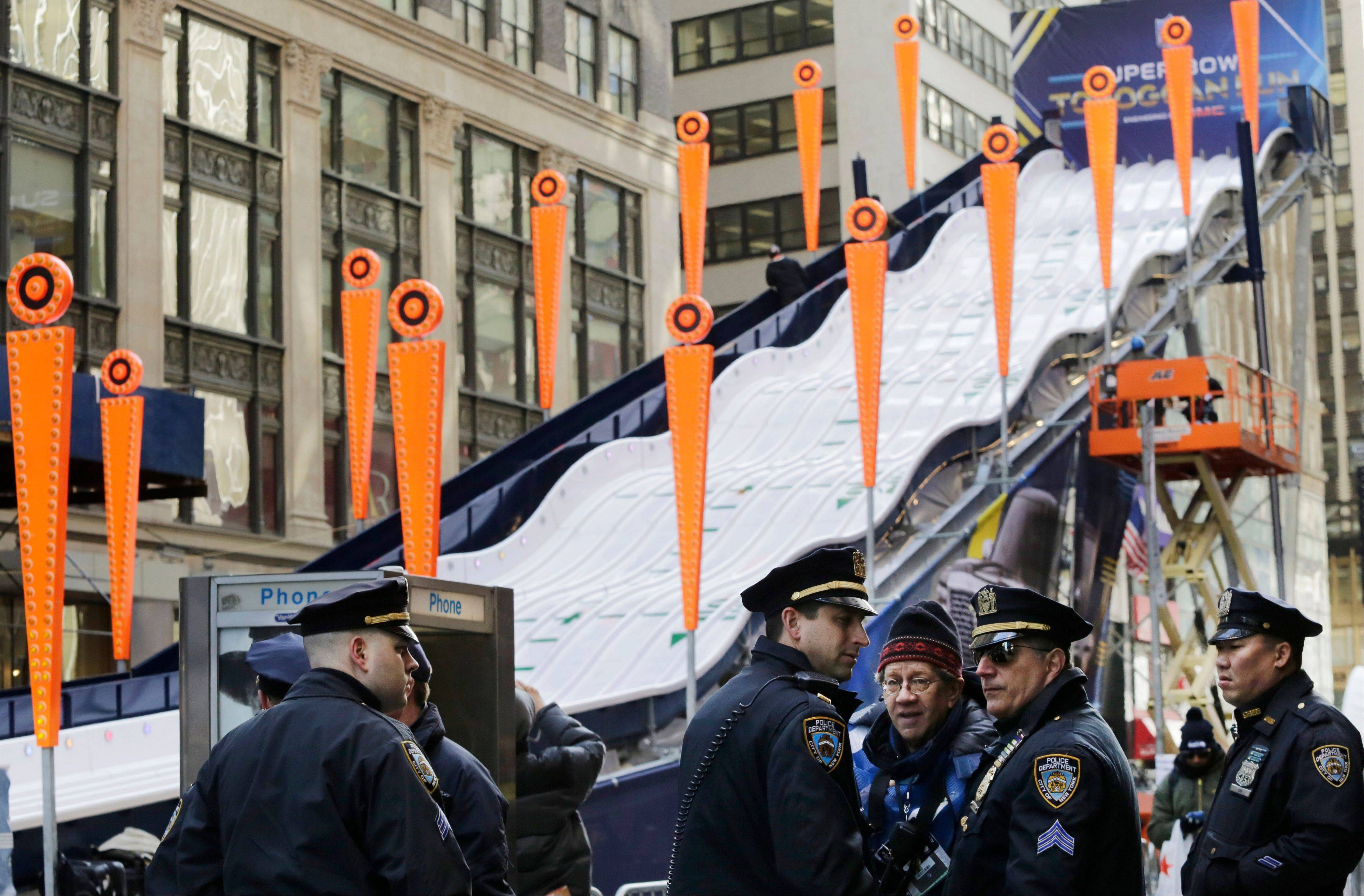 New York City police patrol next to a toboggan run Tuesday on what has been dubbed Super Bowl Boulevard on Times Square. Thirteen blocks of midtown Manhattan have been converted into a temporary festival space leading up to Sunday's Super Bowl.
