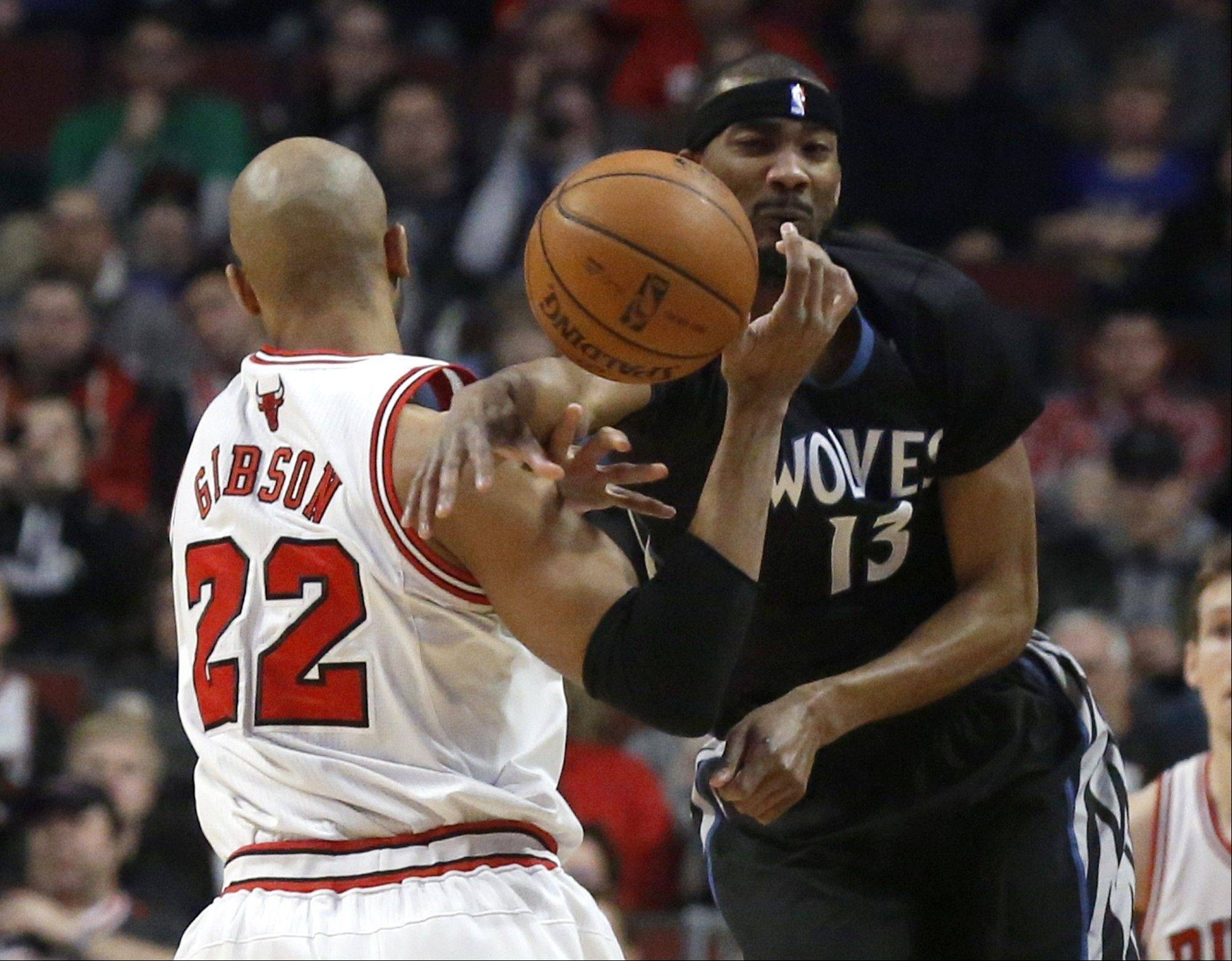 Minnesota Timberwolves forward Corey Brewer (13) knocks the ball away from Chicago Bulls forward Taj Gibson (22) during the first half of an NBA basketball game, Monday, Jan. 27, 2014, in Chicago.