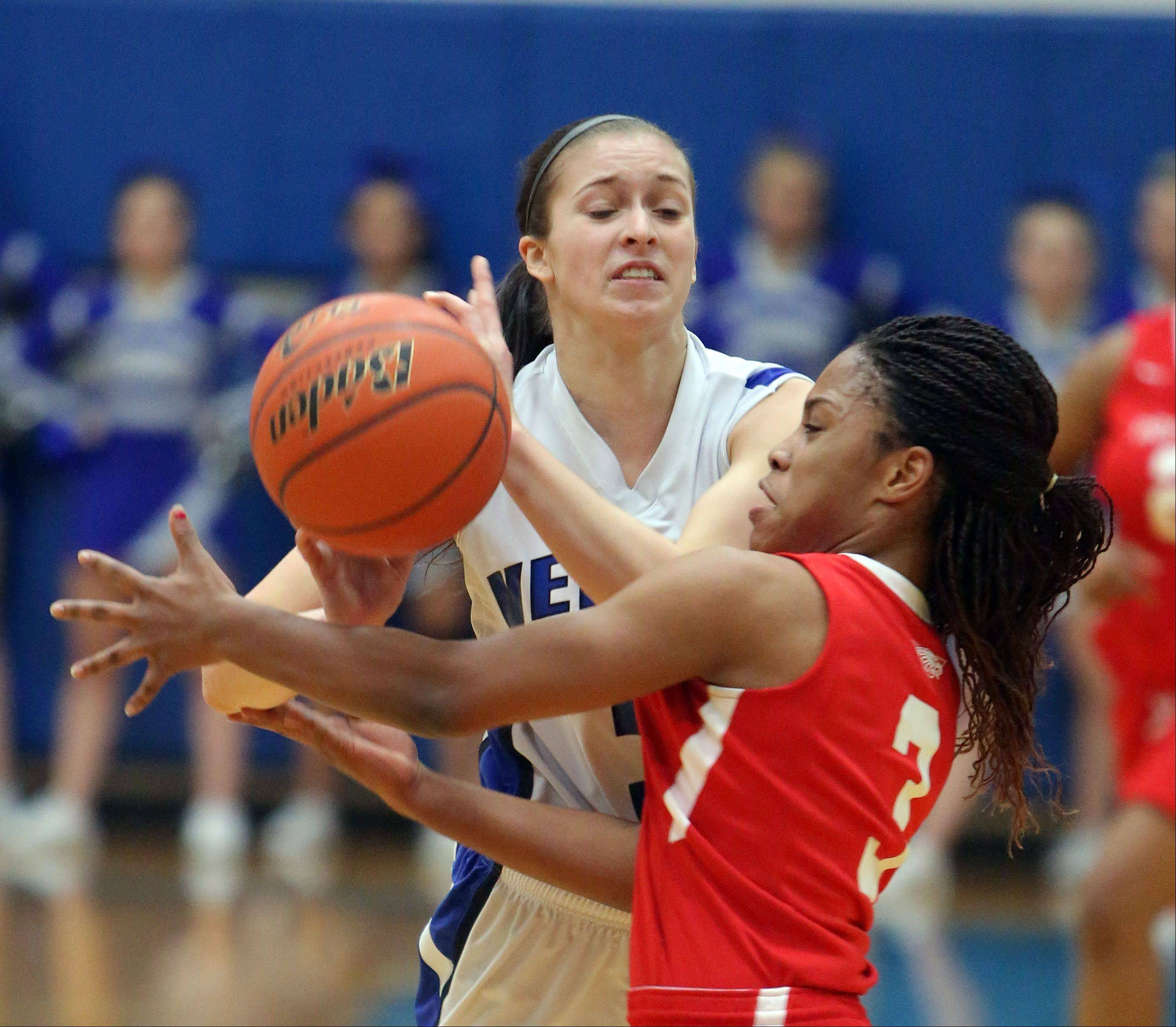 Vernon Hills' Dana Meline, left, and North Chicago's Alexis Means scramble for a loose ball during Wednesday's game in Vernon Hills.