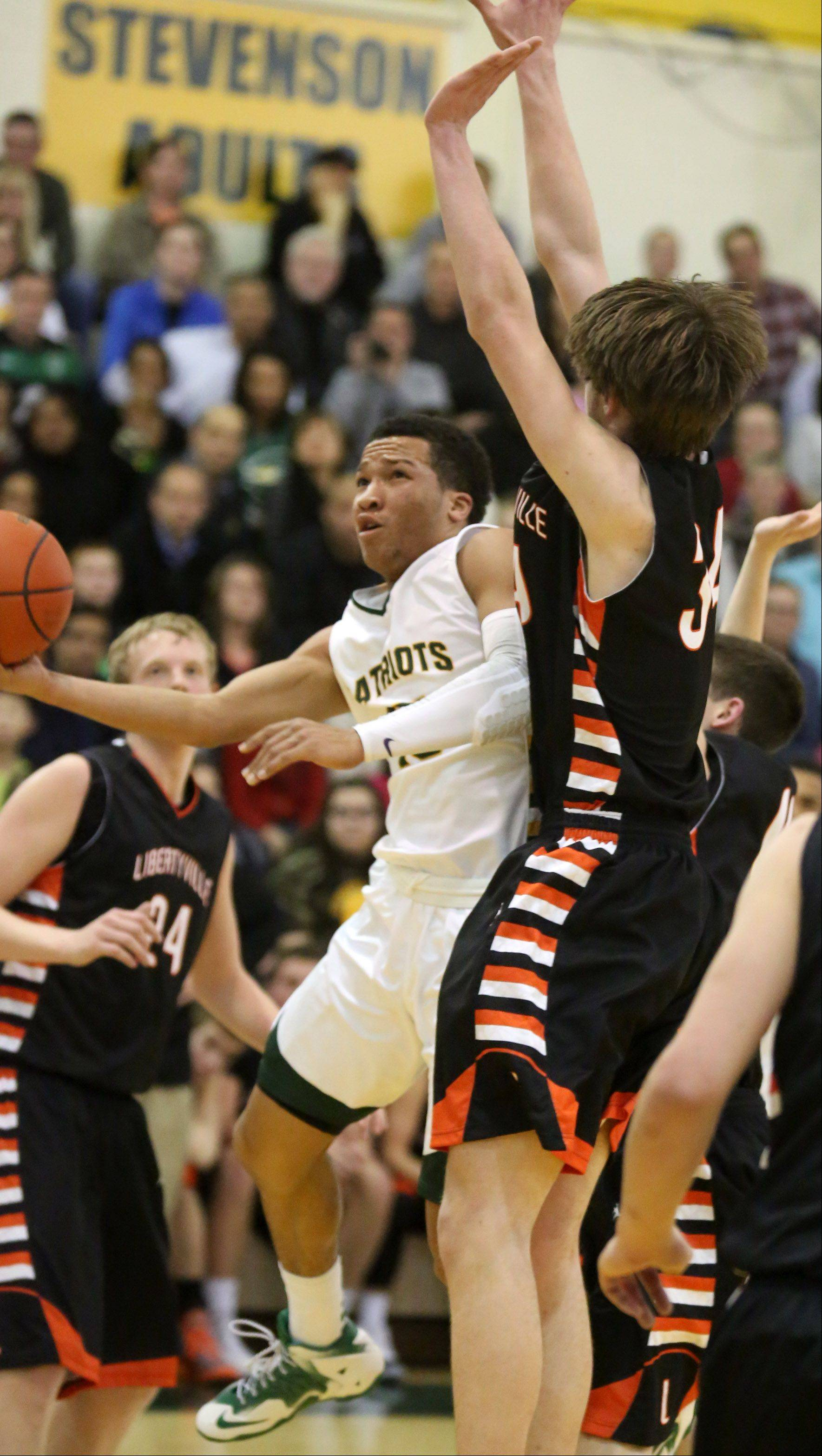 Stevenson's Jalen Brunson shoots around Libertyville center Joe Borcia Friday in Lincolnshire.