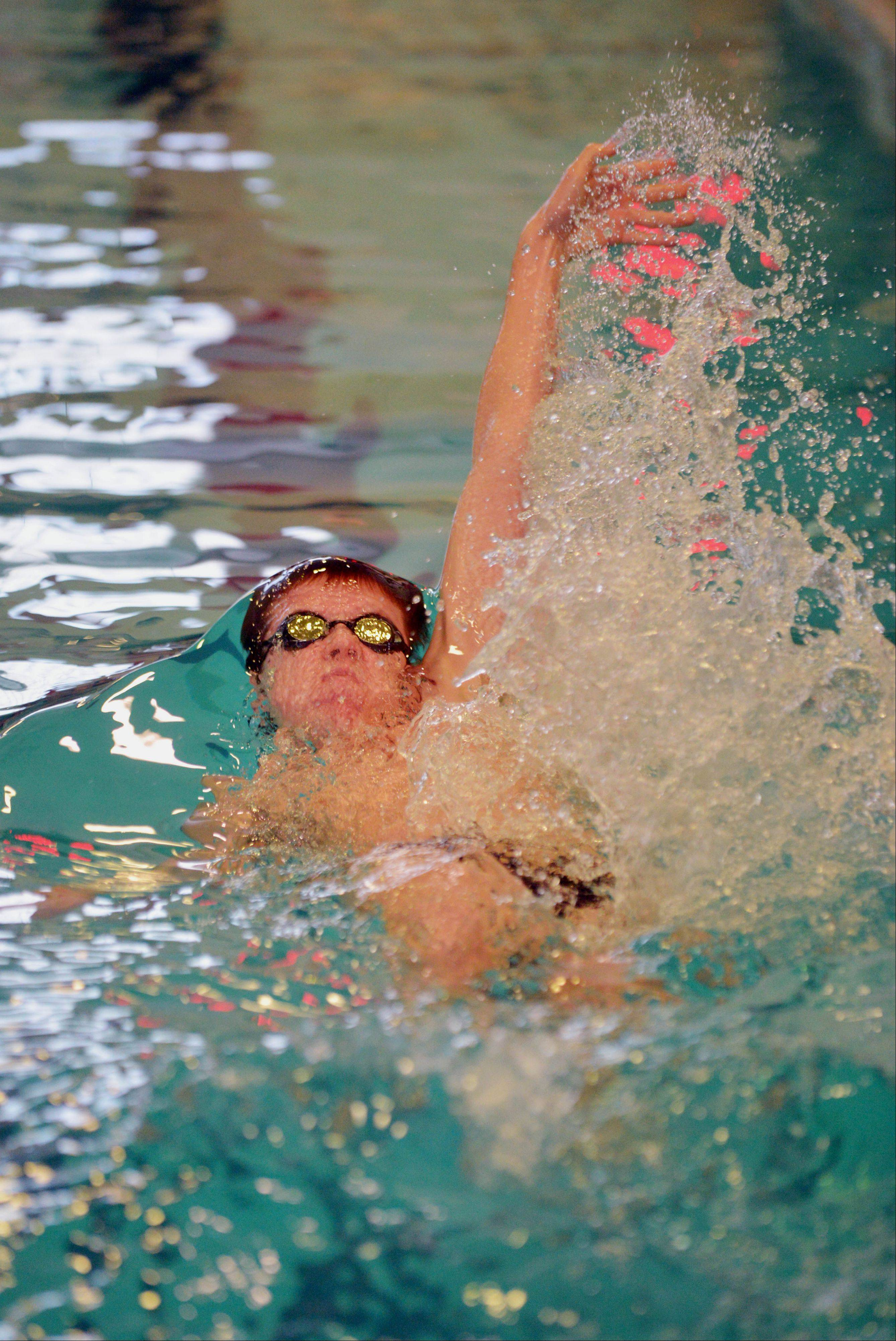 Addison Trail's Ethan Wallace competes in the 200-yard medley relay during the Hinsdale Central boys swimming invitational Saturday.