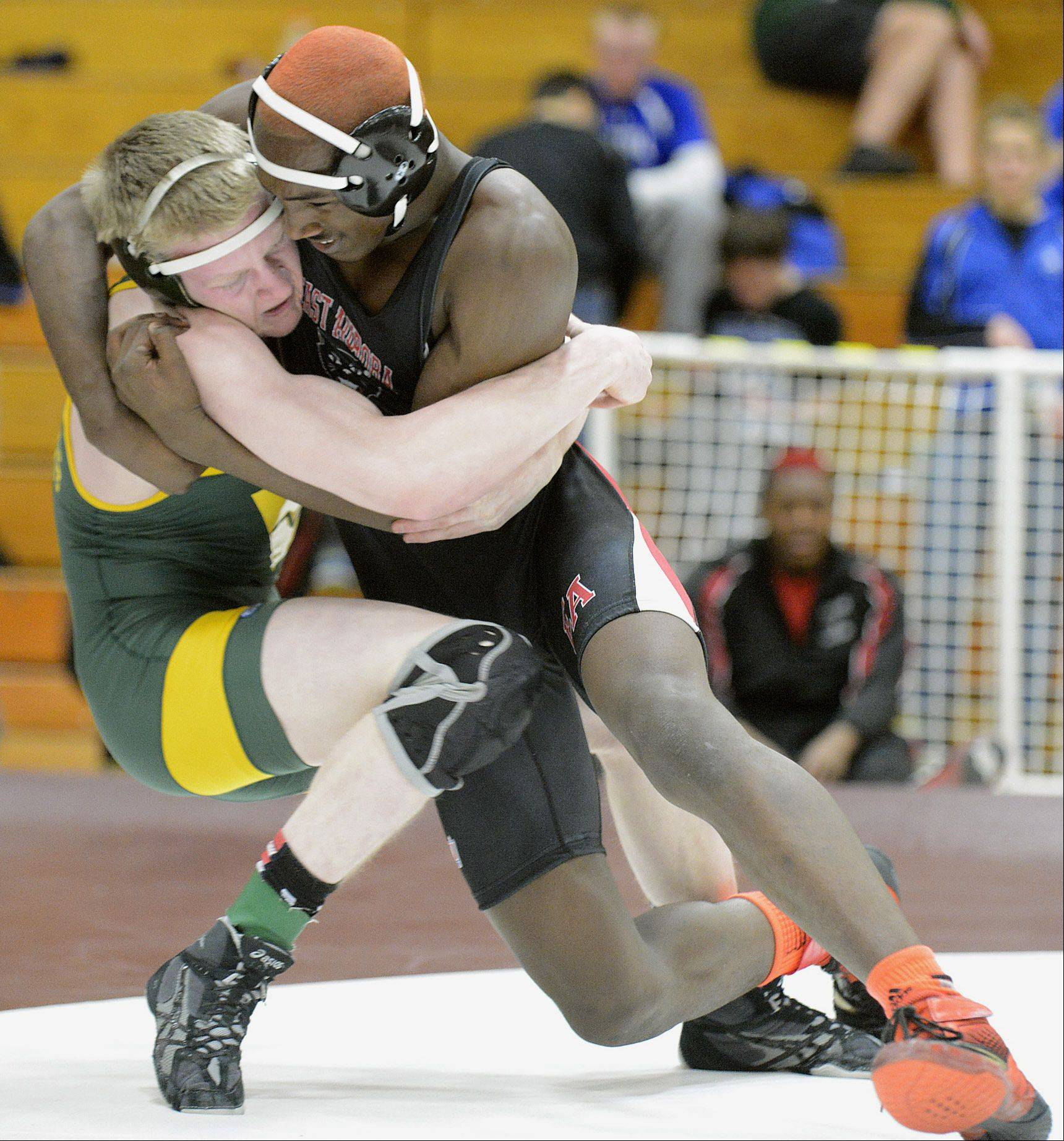 Waubonsie Valley's Jack Timberlake, left, and East Aurora's Tim Young compete in the 170-pound match final at the Upstate 8 Conference championship in Elgin.