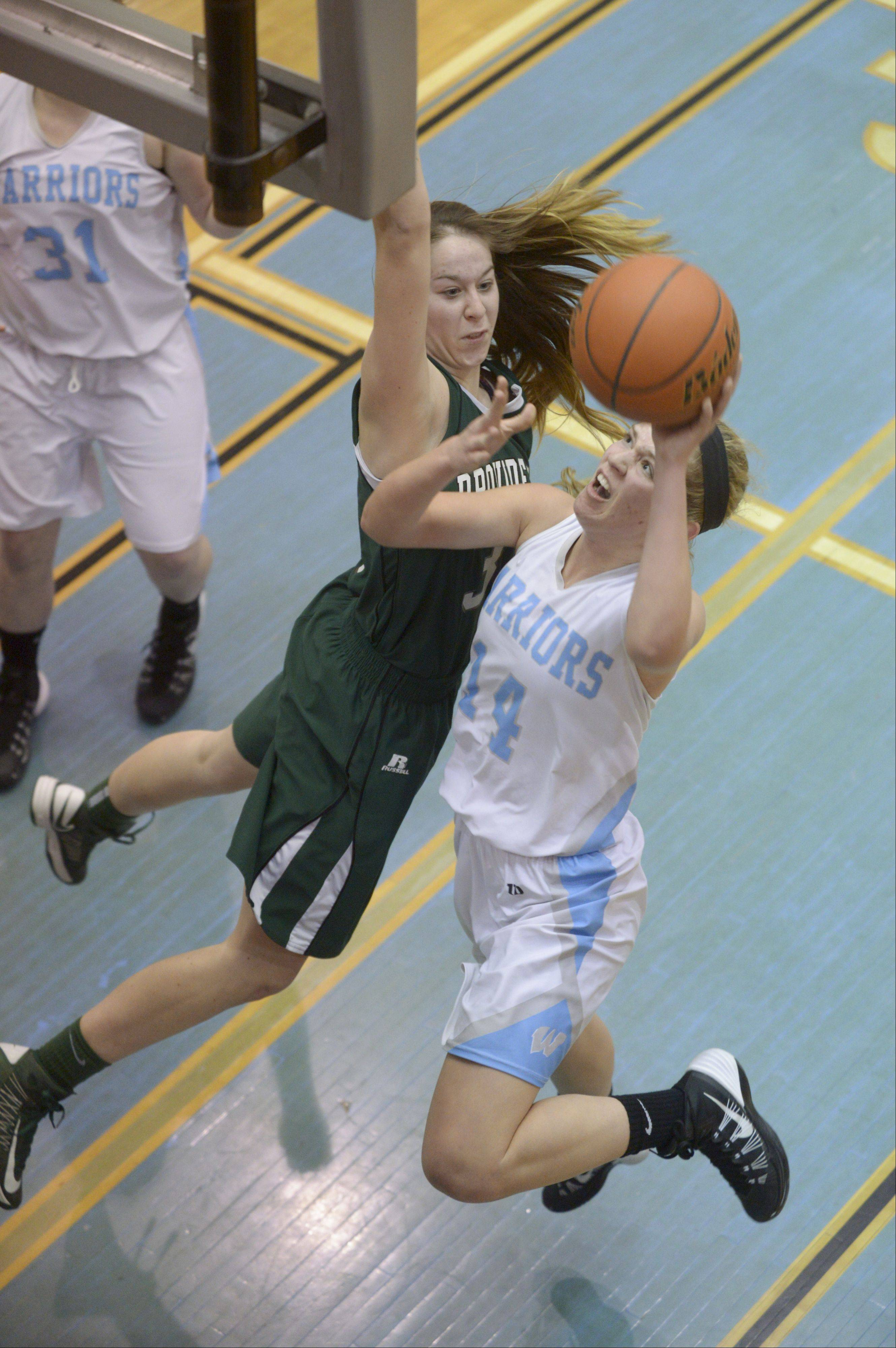 Willowbrook's Lauren Carroll lays up a shot past Providence's Maeve Garvey Monday.