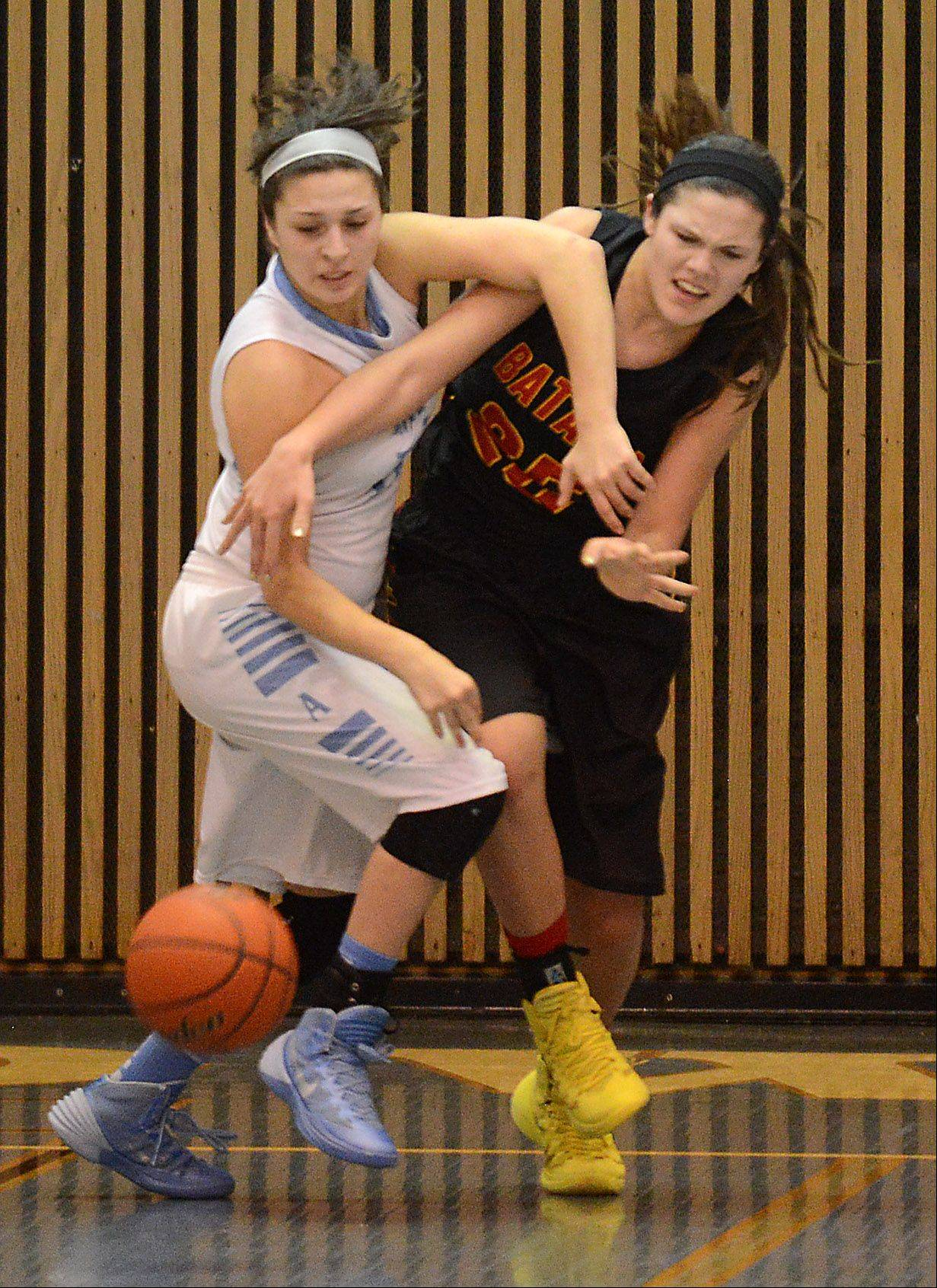 Joliet Catholic's Andriana Acosta (10) and Batavia's Hannah Frazier (25) battle for a loose ball during Monday's 24th annual McDonald's Shootout at Willowbrook High School.