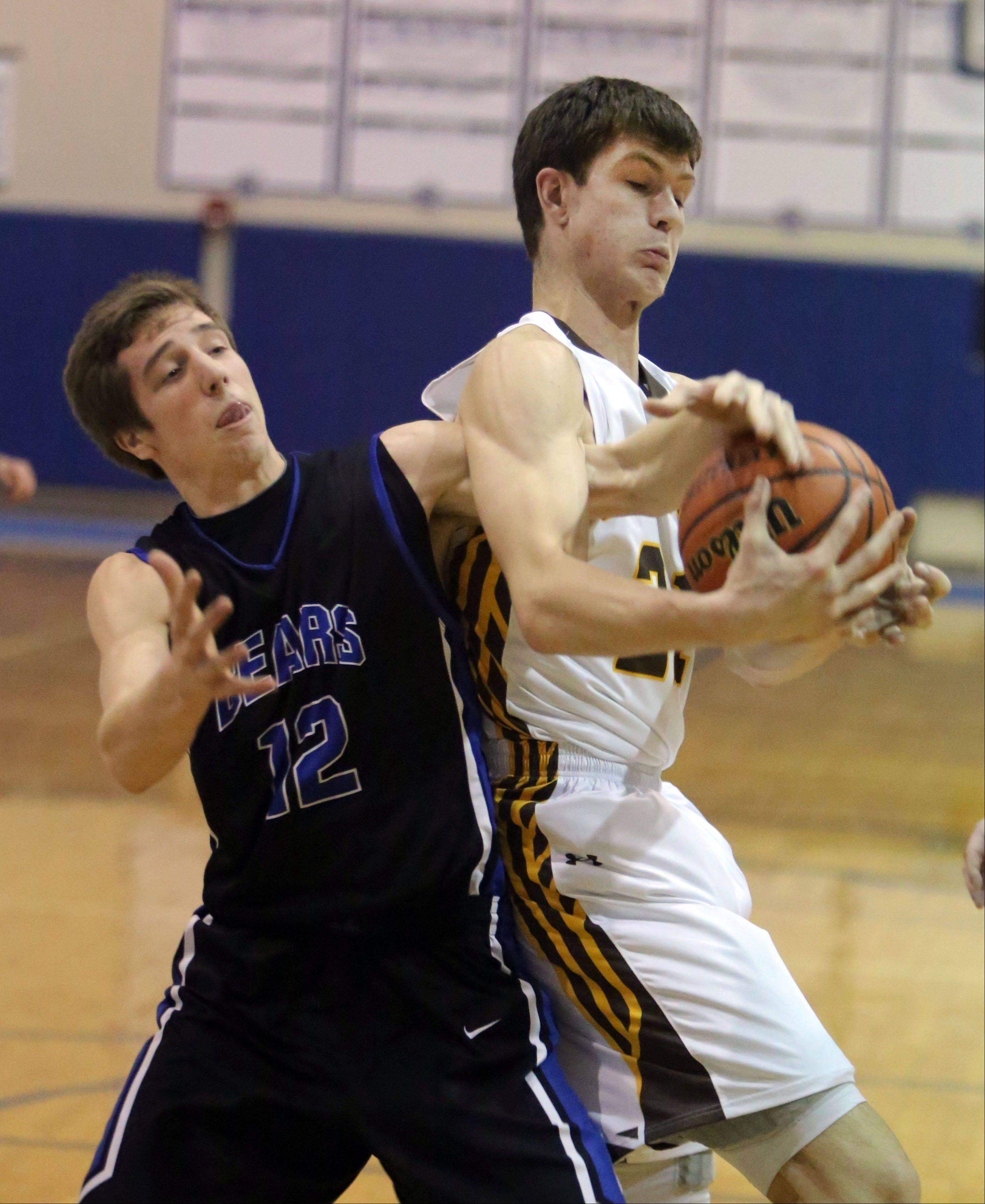 Lake Zurich's Corey Helgeson, left, and Carmel's John George fight for a rebound during the 2nd annual Lake Zurich Martin Luther King Classic on Monday.