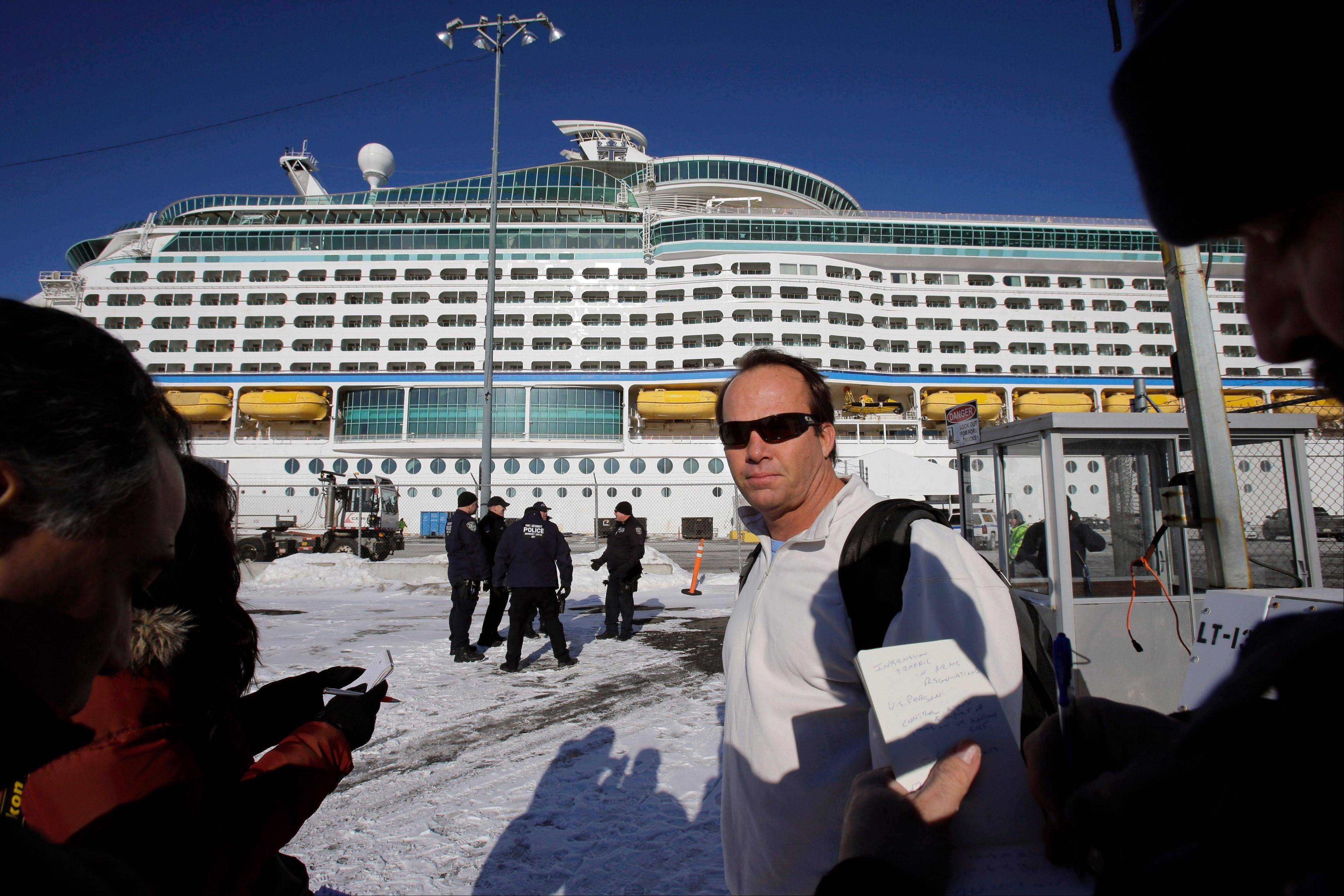 Rick O�Shea, with the Explorer of the Seas cruise ship behind him after it docked in Bayonne, N.J., Wednesday, said his company is preparing to disinfect the ship. The U.S. Centers for Disease Control and Prevention said Wednesday its latest count puts the number of those sickened aboard the Explorer of the Seas at 630 passengers and 54 crew members.