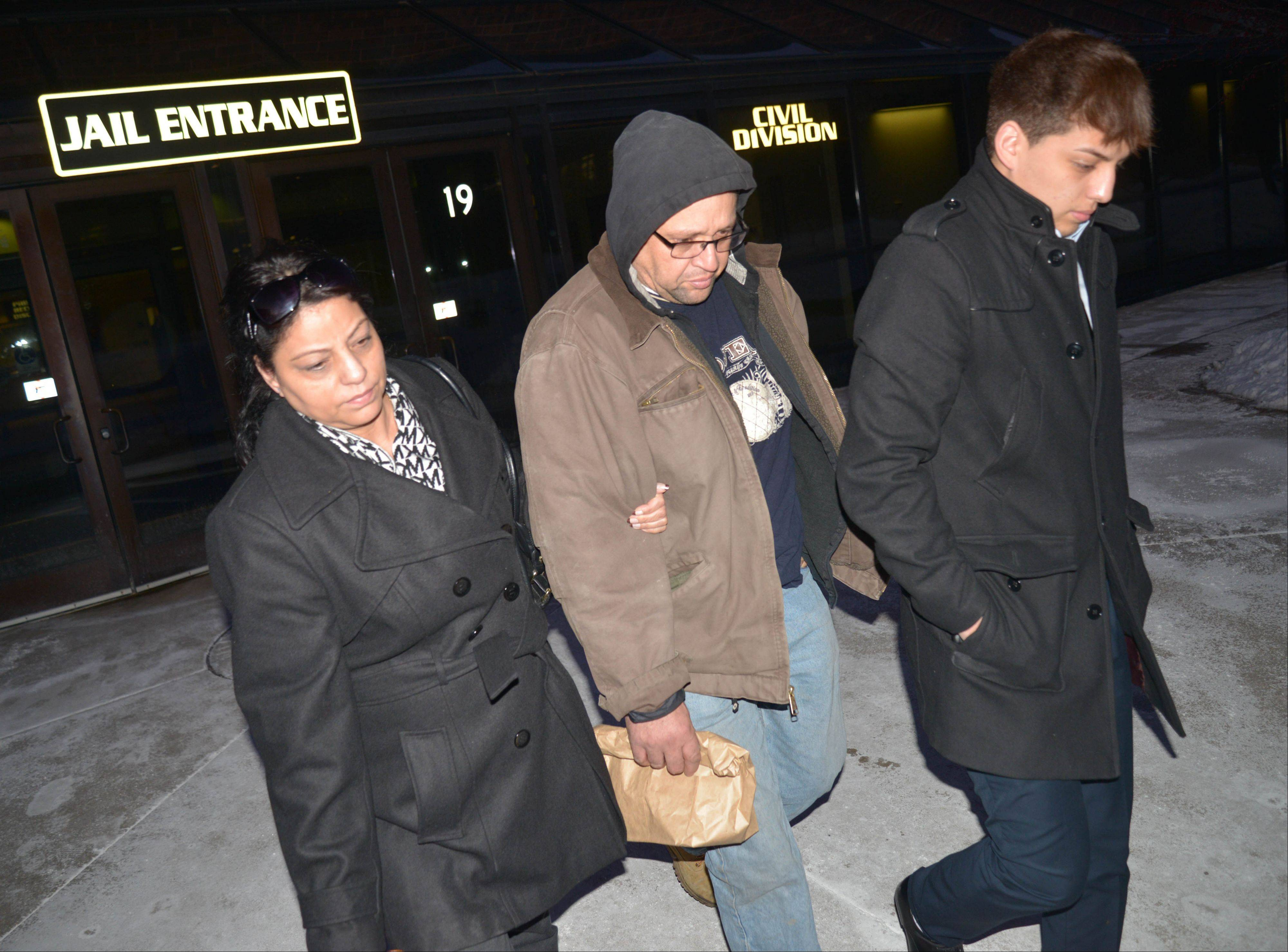 Renato V. Velasquez, center, was released Wednesday evening from the DuPage County jail where he had been held after a fatal accident that killed a tollway worker Monday night along I-88 near Aurora.