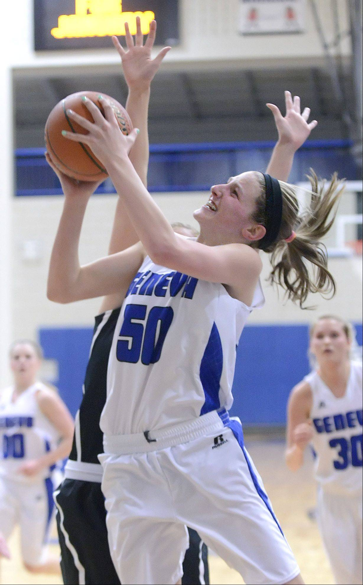 Geneva�s Grace Loberg shoots over a block by Fenwick�s Kelly Canoy in the second quarter on Wednesday, January 29.