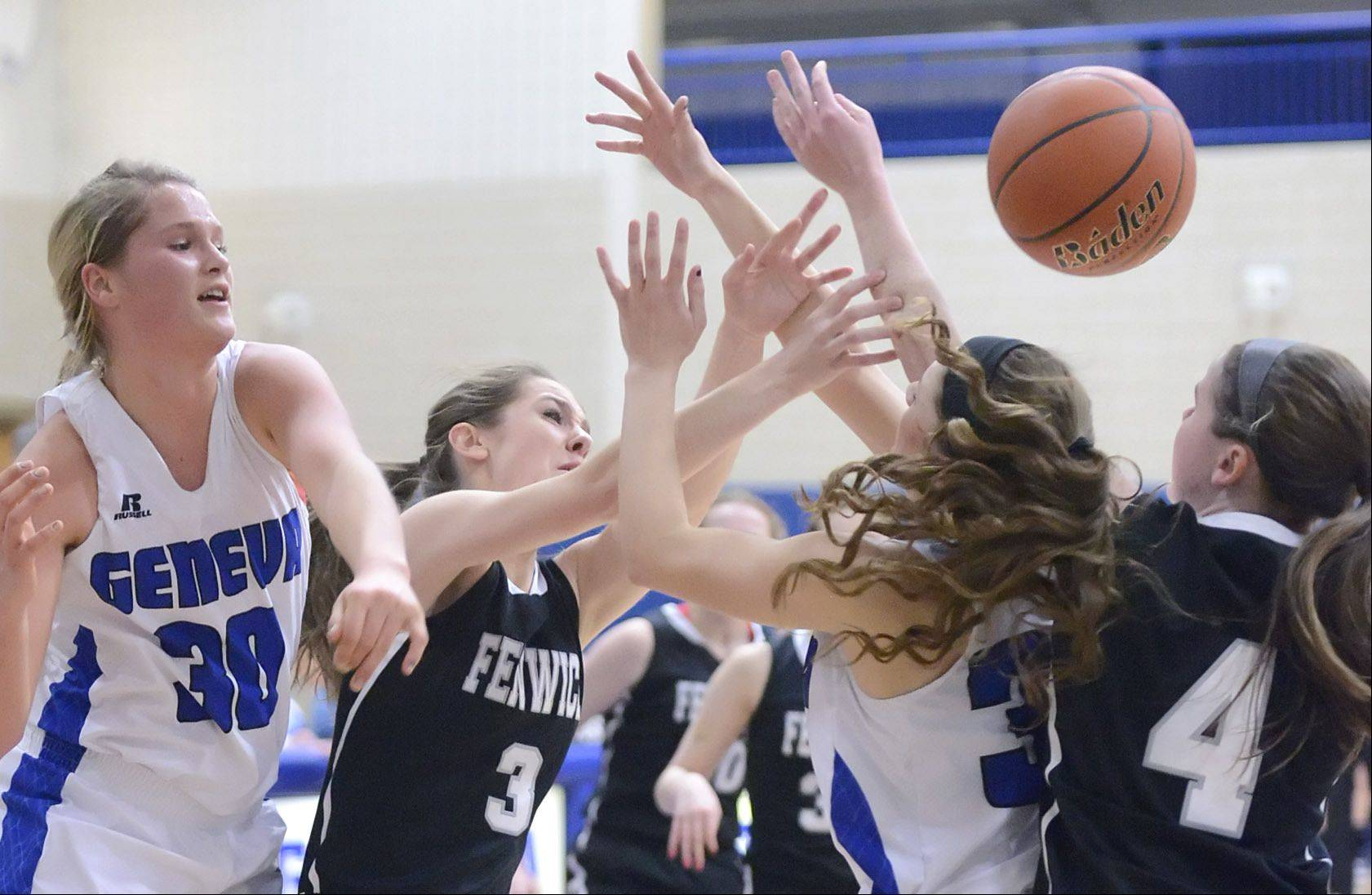Geneva�s Janie McCloughan and Madeline Dunn scramble for a loose ball with Fenwick�s Katie Dvorak and Megan Hussey in the second quarter.