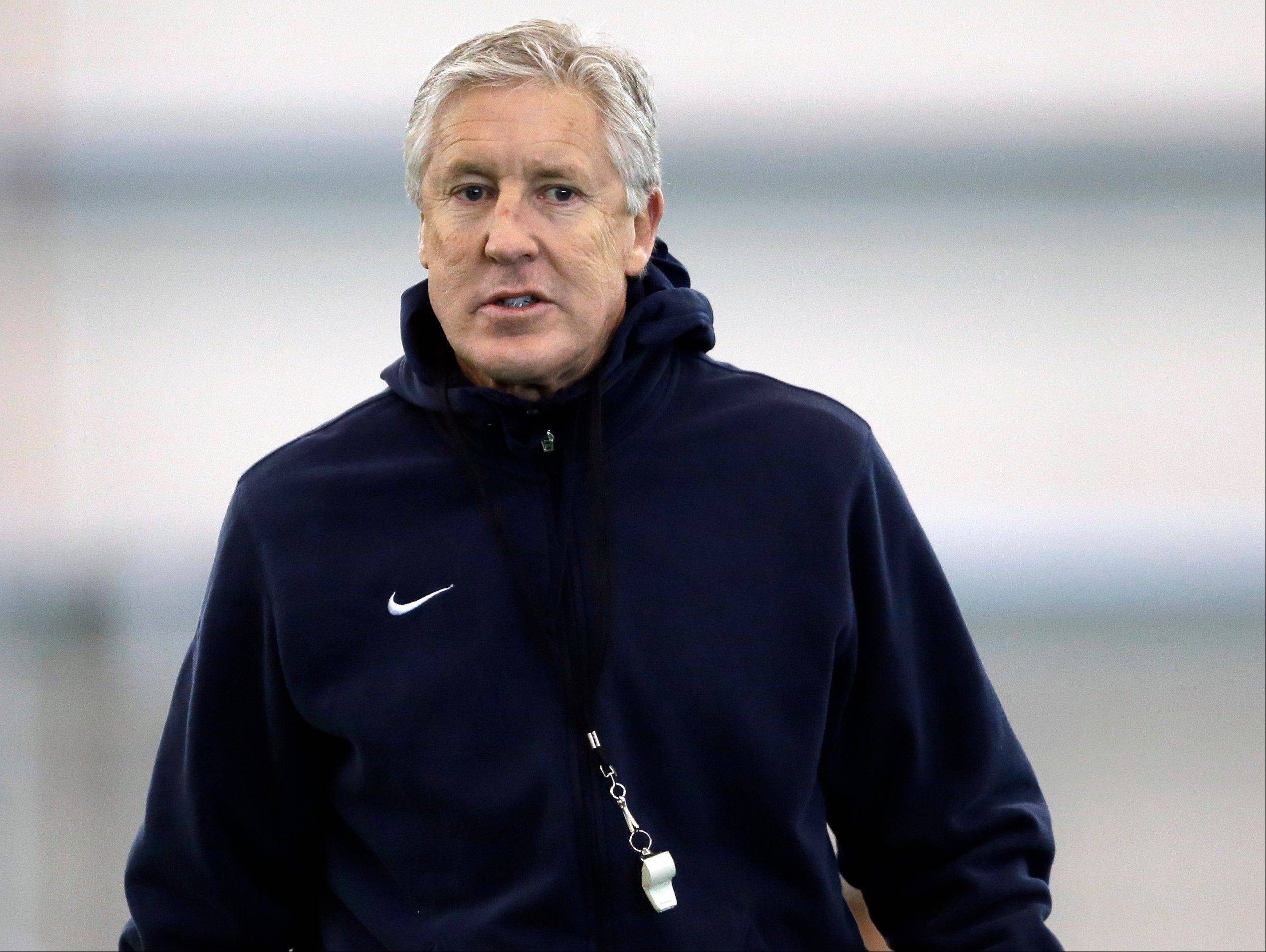 Seattle Seahawks head coach Pete Carroll watches his team warm up for NFL football practice Wednesday, Jan. 29, 2014, in East Rutherford, N.J. The Seahawks and the Denver Broncos are scheduled to play in the Super Bowl XLVIII football game Sunday, Feb. 2, 2014. (AP Photo/Jeff Roberson)