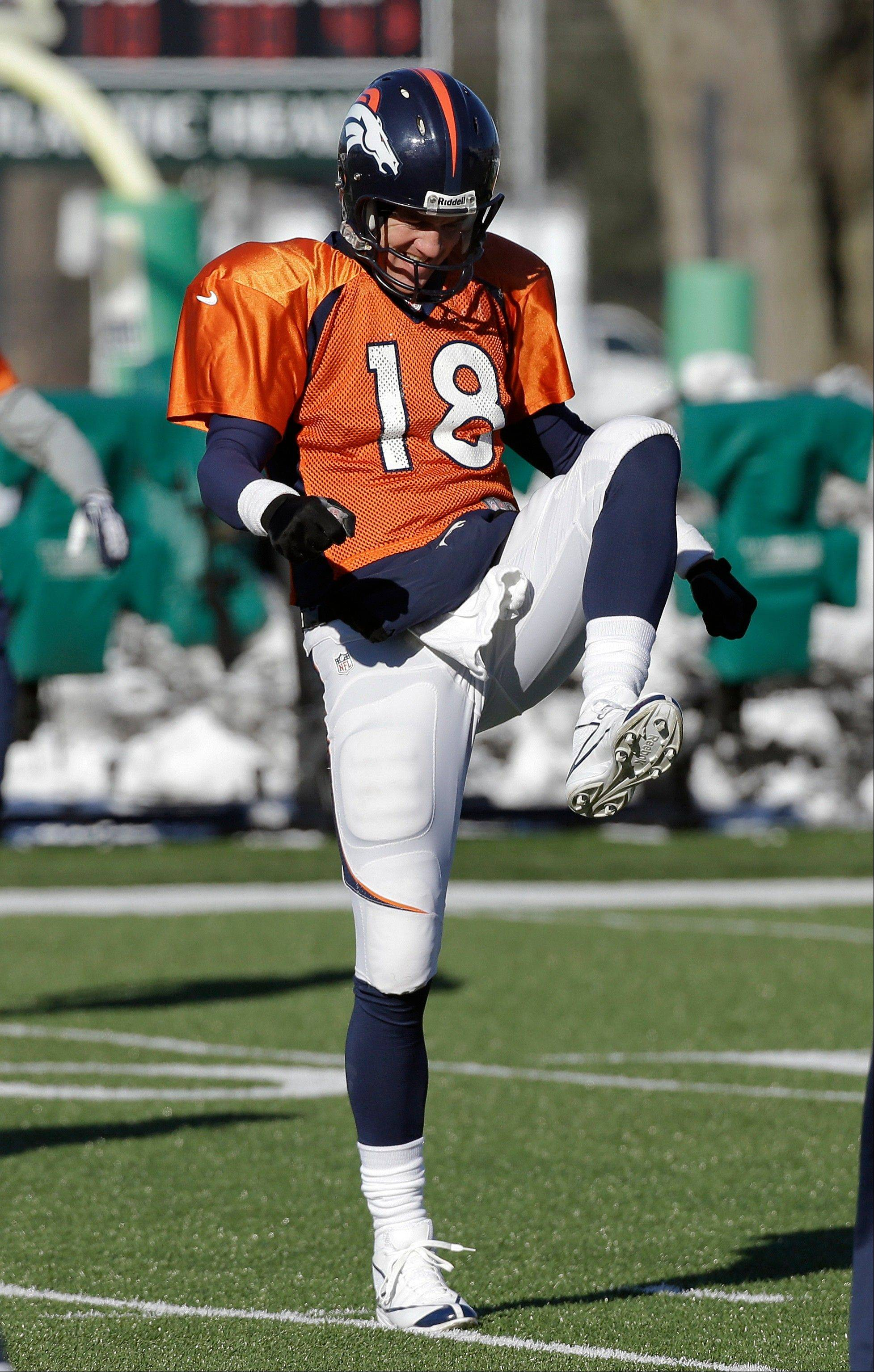 Denver Broncos quarterback Peyton Manning stretches during practice Wednesday, Jan. 29, 2014, in Florham Park, N.J. The Broncos are scheduled to play the Seattle Seahawks in the NFL Super Bowl XLVIII football game Sunday, Feb. 2, in East Rutherford, N.J. (AP Photo/Mark Humphrey)