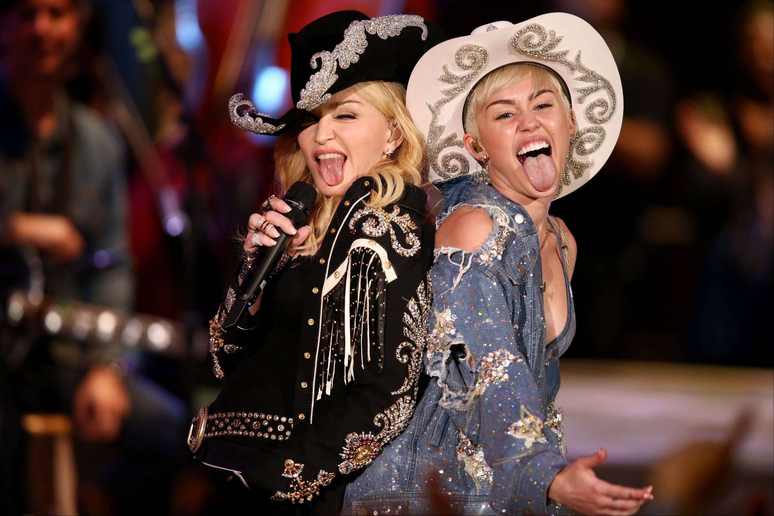 "Miley Cyrus performs with Madonna for an ""MTV Unplugged"" special that is set to air Wednesday."