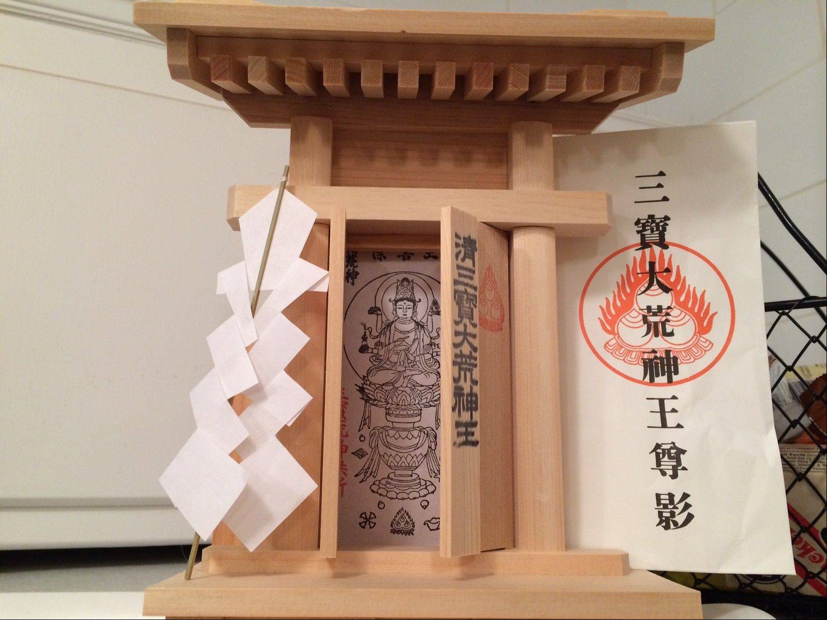 This shrine with an image of the Kojin, also known as the fire god, was purchased on a pilgrimage to Kiyoshikojin Seicho-ji, a temple complex north of Osaka, Japan. The temple is the seat of Japan's most prominent shrine to Kojin, and vendors in the area sell shrines like this one.