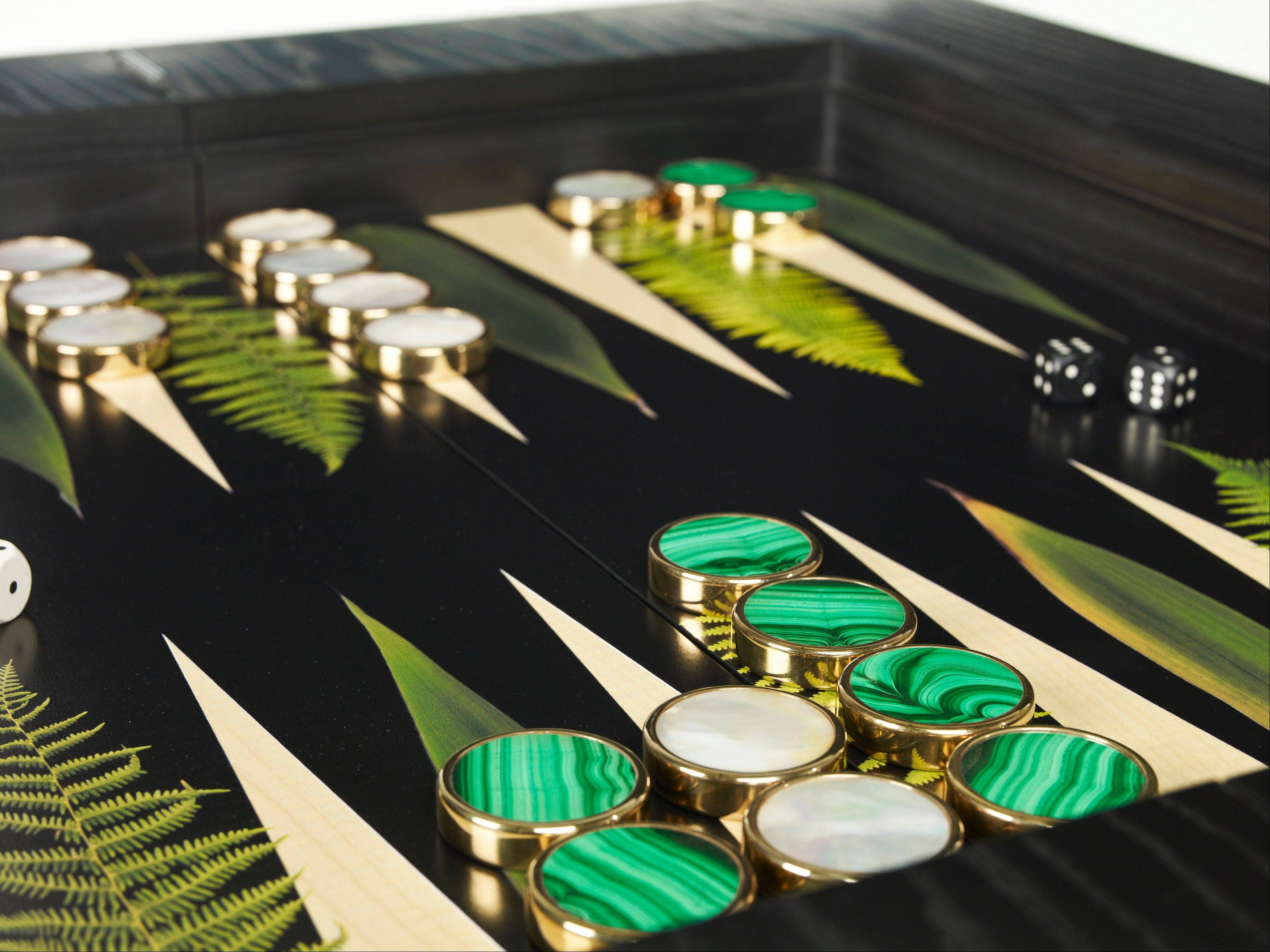A Louisa backgammon set from Alexandralldesign.com. Alexandra Llewellyn creates custom sets that can be highly personalized. Bespoke game pieces made of semi-precious stones like lapis lazuli, malachite and jasper are encased in polished brass, and may be engraved.