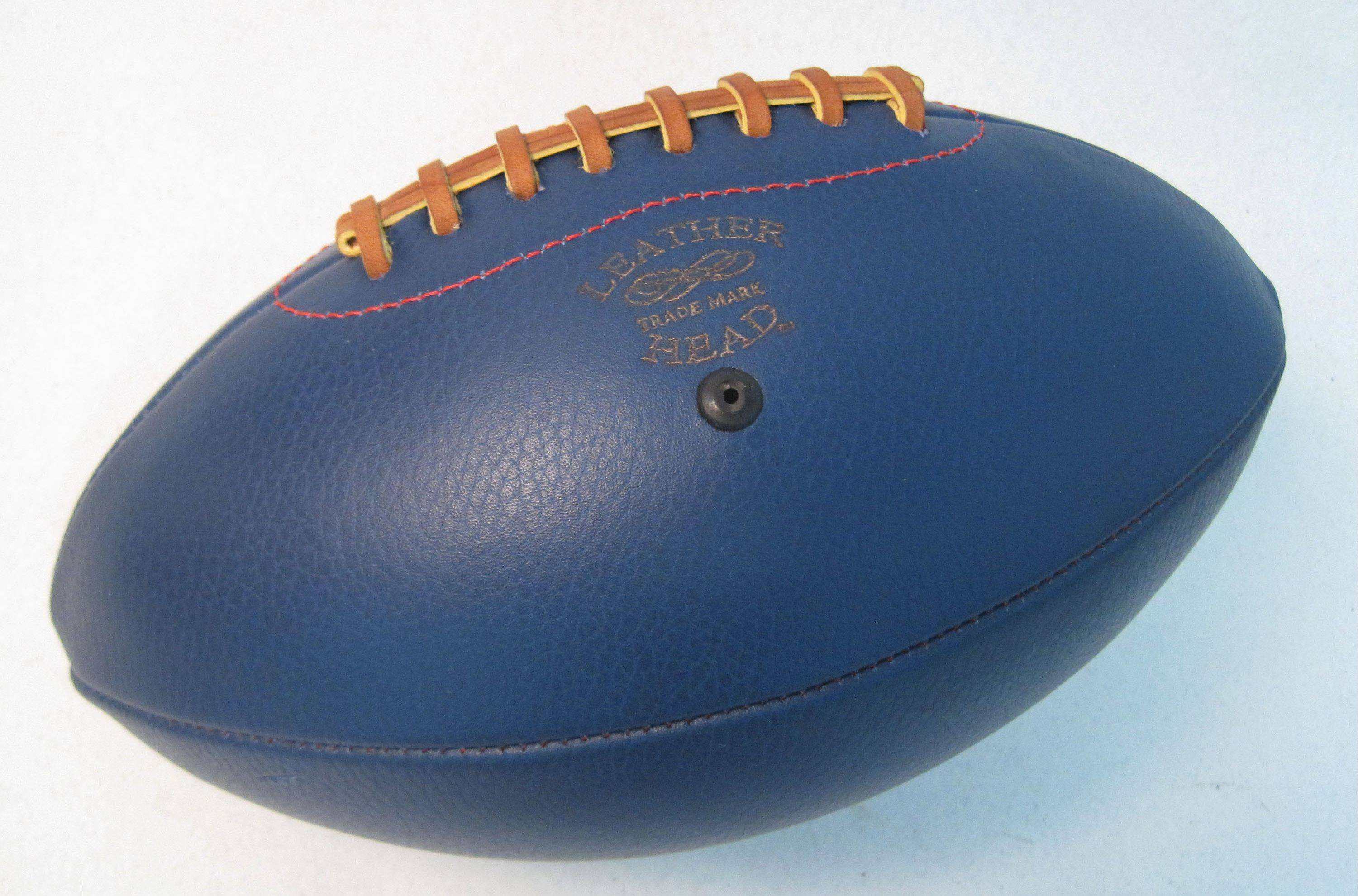 A Bespoke Global Big Blue, Leather Head Football by Paul Cunningham. This football is handmade from a beautiful hide of Royal Blue leather with a light pebble grain and stitched with red thread.