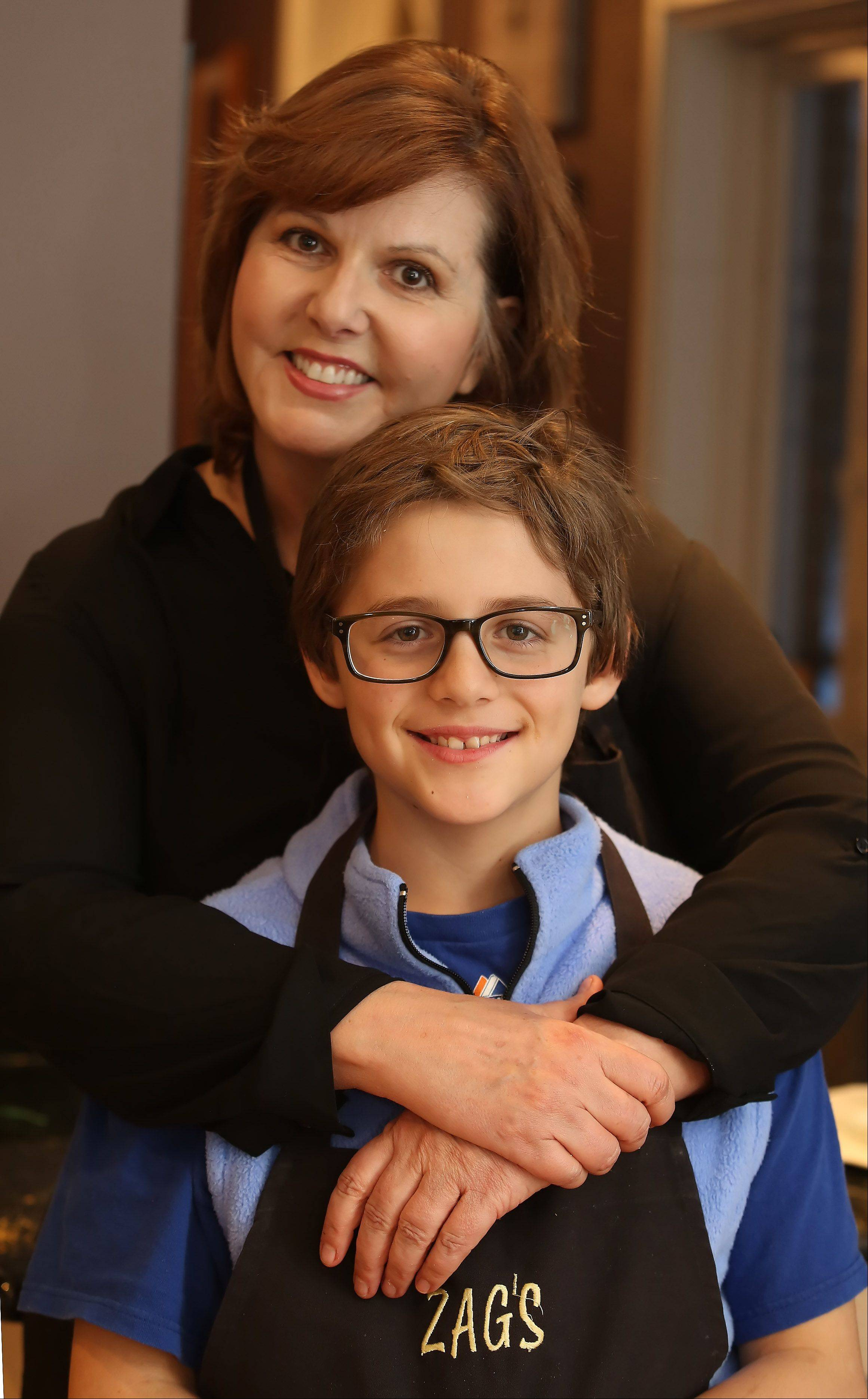 Theresa Zagnoli with her son, Joe, 10, make spicy shrimp salad in their Bannockburn kitchen.