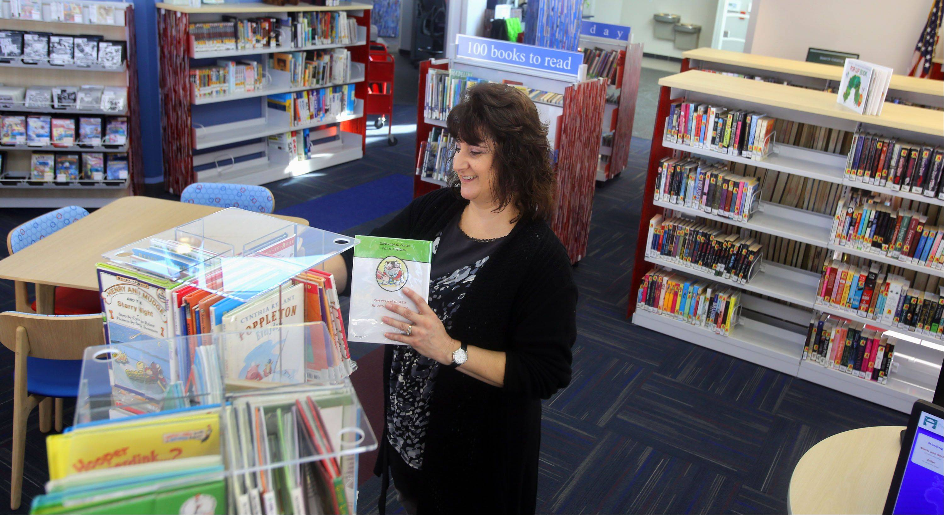 Children's programmer Lisa Orsini enjoys the $1.1 million renovation at the Poplar Creek Public Library District's Sonya Crenshaw branch in Hanover Park.