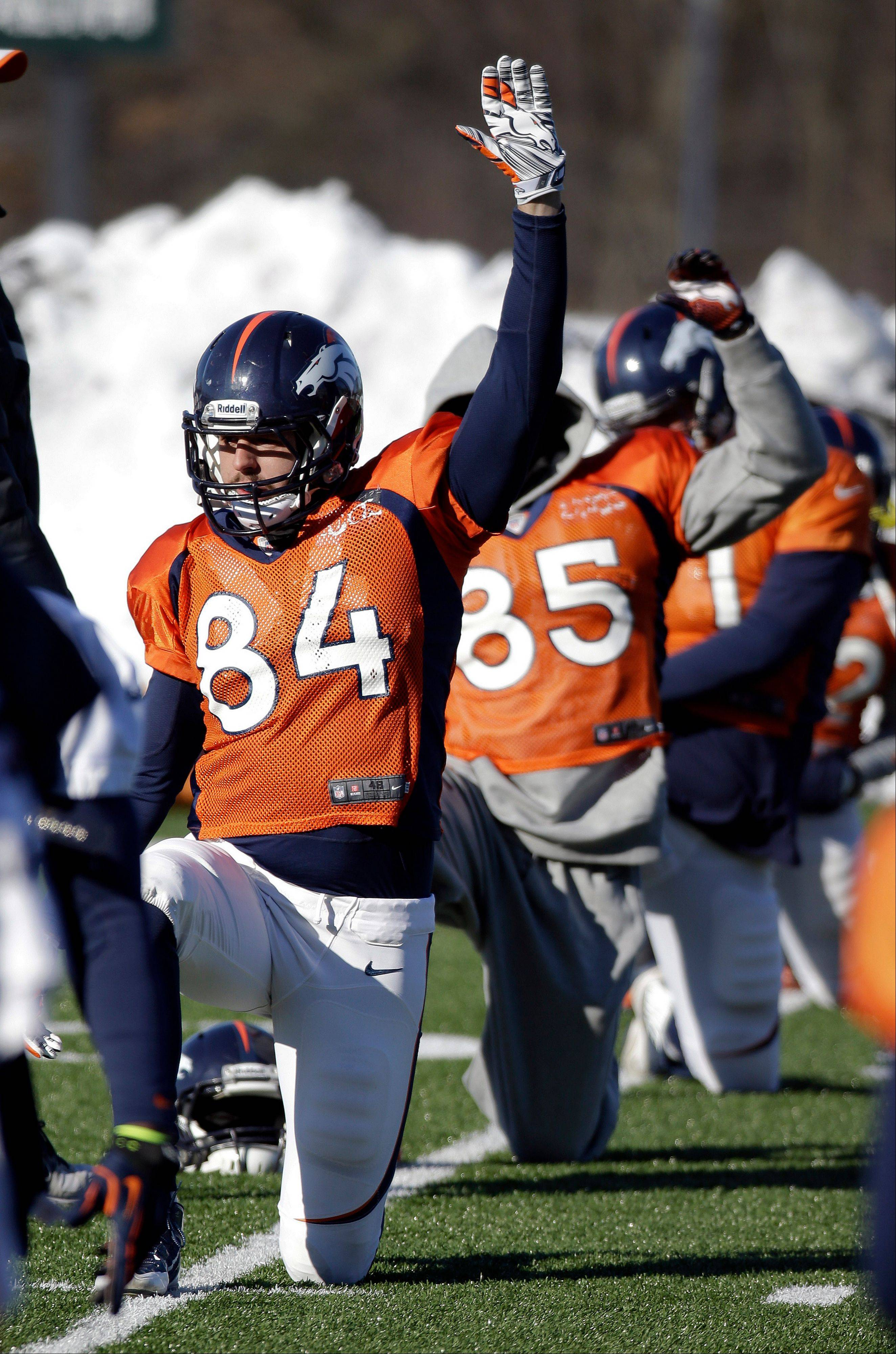 Denver Broncos tight end Jacob Tamme (84) stretches during practice Wednesday, Jan. 29, 2014, in Florham Park, N.J. The Broncos are scheduled to play the Seattle Seahawks in the NFL Super Bowl XLVIII football game Sunday, Feb. 2, in East Rutherford, N.J.