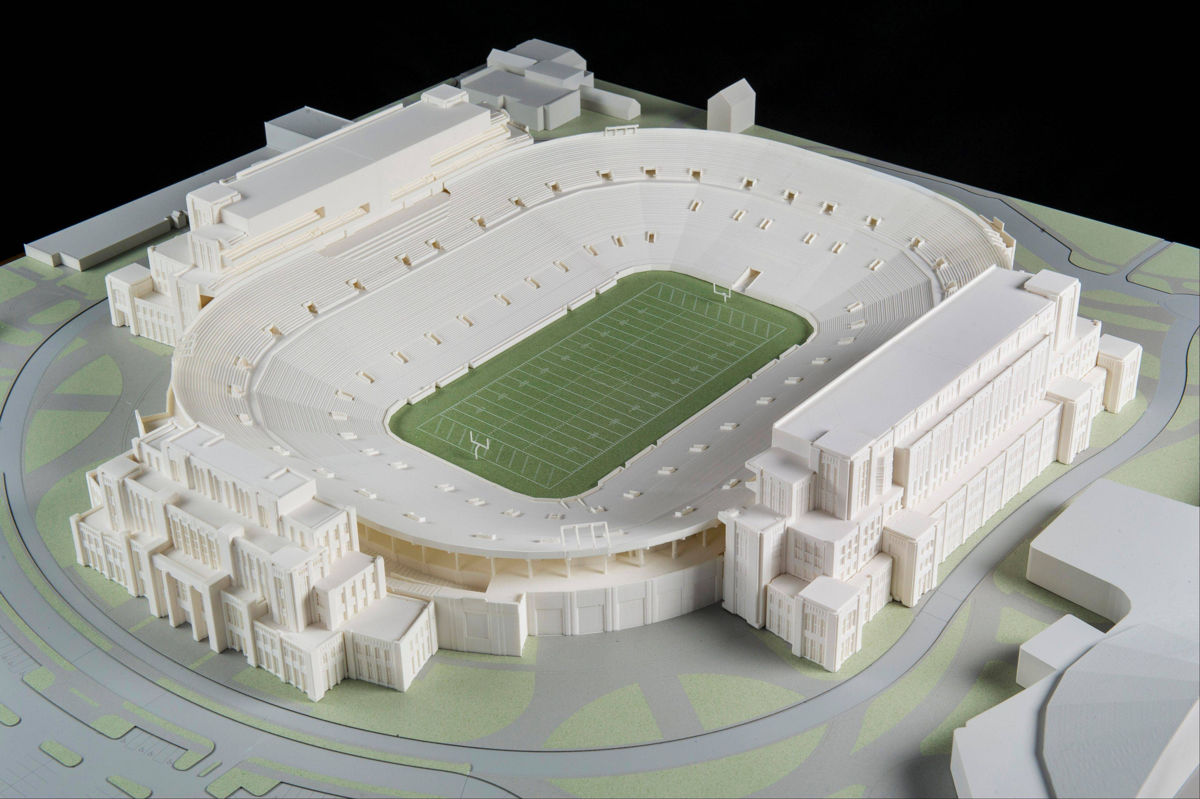 In this Jan. 17, 2014 photo is a model of The University of Notre Dame's new football stadium. Notre Dame announced plans Wednesday, Jan. 29, 2014 to expand the schoolís 84-year-old football stadium, adding up to 4,000 premium seats and spending about $400 million to add buildings on three sides of the ìHouse that Rockne Built.î